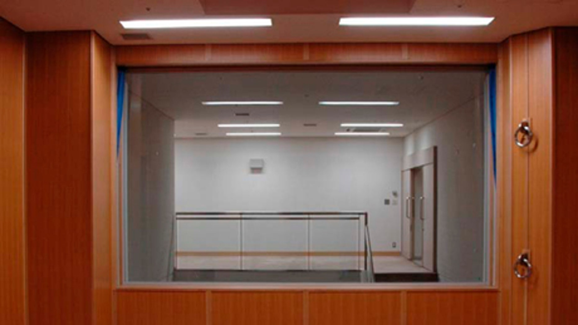 In this photo taken and released on  by Japan's Justice Ministry, the trapdoor where a condemned criminal is to stand is marked with a red double square on the floor in an execution room at Tokyo Detention Center when the local media are allowed a rare tour of Tokyo's main gallows in a bid to create more public awareness about capital punishment. Three death row inmates in Japan were executed by hanging on Thursday, March 29, 2012, the country's first executions in more than a year and a half. Japan, along with the United States, is one of the few industrialized countries that still has capital punishment. The room behind the glass window is for witnesses to stand and observe the execution.
