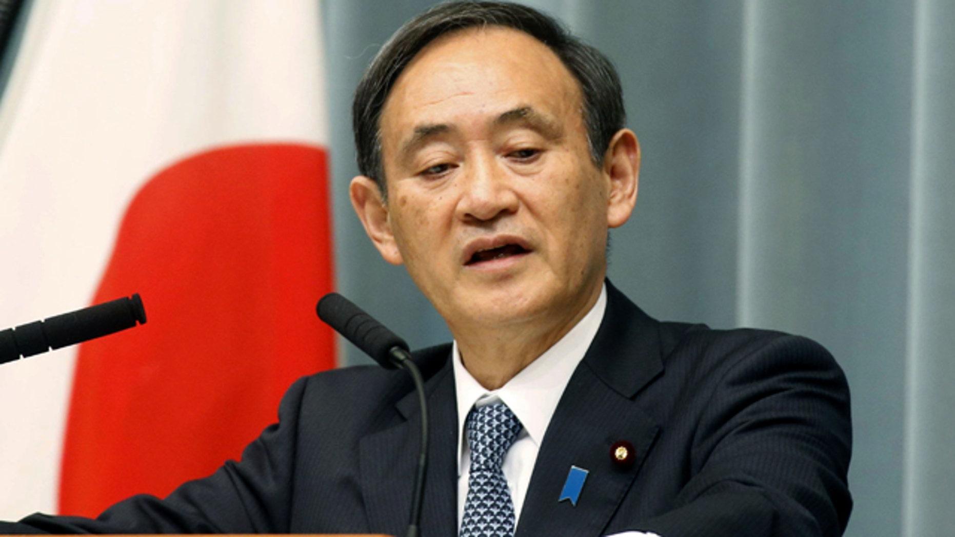 Jan. 26, 2015: Japan's government spokesman Yoshihide Suga speaks at a press conference in Tokyo. (AP Photo/Kyodo News)