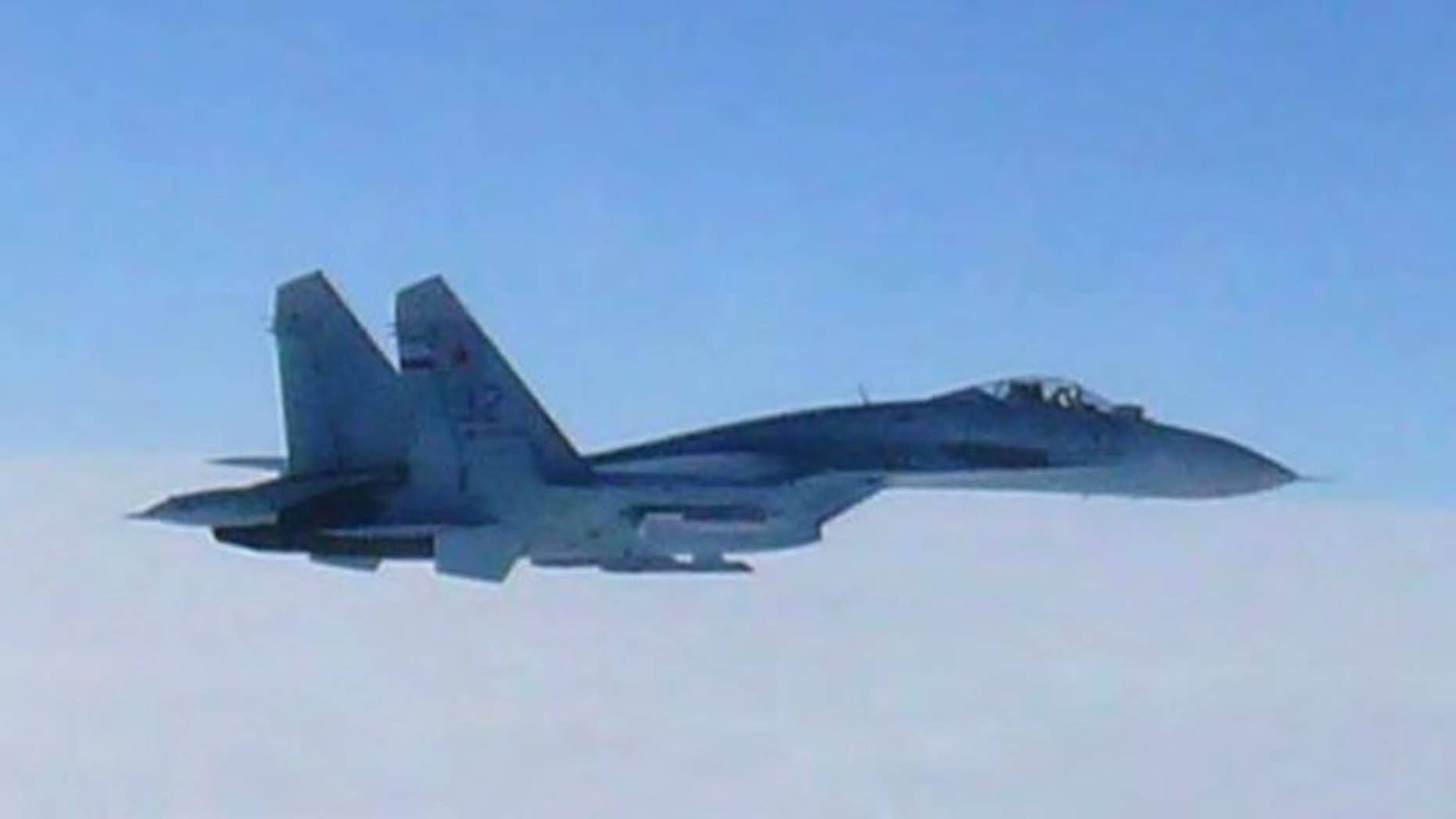 FILE - In this Feb. 7, 2013 file photo taken by Japan Air Self-Defense Force and released by the Joint Staff Office of the Defense Ministry of Japan, Russian fighter jet SU-27 flies over the sea off the Japanese island of Hokkaido when the Defense Ministry said two SU-27 jets, including the one shown in this photo, briefly intruded into Japanese airspace in the afternoon off the coast of Rishiri island on Hokkaido's west coast, prompting Japan's air force to scramble jets. Japan's government said Wednesday, April 15, 2015 that the number of scrambles by the country's warplanes has surged in recent years to levels nearly matching the Cold War era amid growing activity by China and Russia in the region. (The Joint Staff Office of the Defense Ministry of Japan via AP, File)