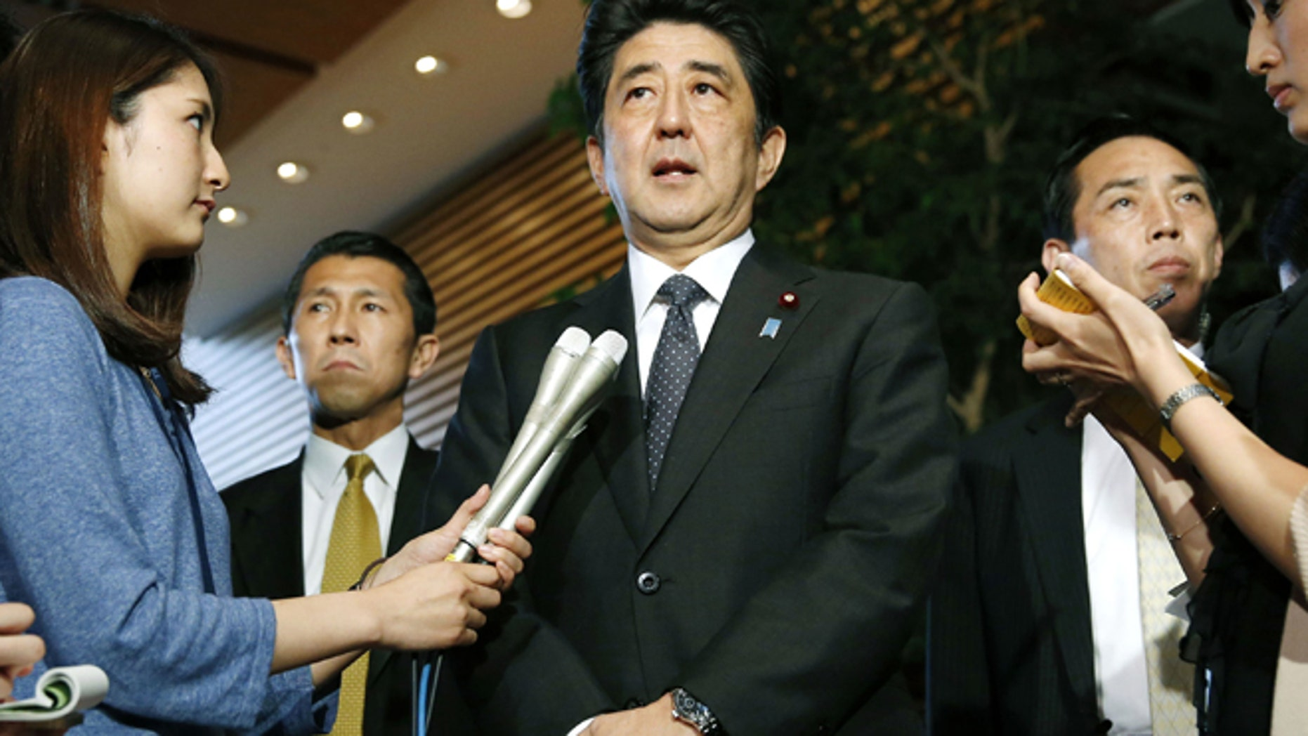 May 29. 2014: Japanese Prime Minister Shinzo Abe, center, speaks to the media about a three-day talks in Stockholm with North Korea at the prime minister's official residence in Tokyo. (AP)