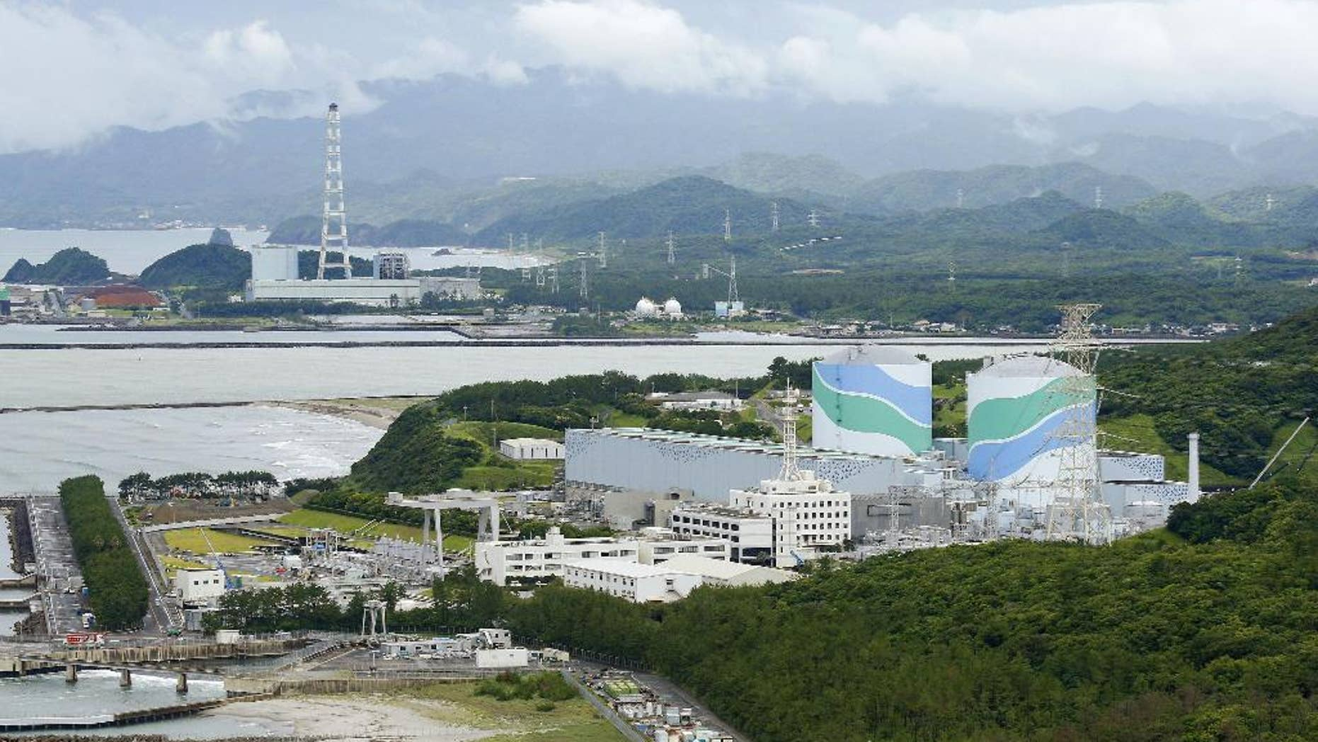 This June 2013 photo shows No. 1, right, and No. 2 at Sendai nuclear power station in Sendai, Kagoshima prefecture, southwestern Japan. A prominent volcanologist disputed Japanese regulators' conclusion that two nuclear reactors were safe from a volcanic eruption in the next few decades, saying Friday, Oct. 17, 2014 that such a prediction was impossible. A cauldron eruption at one of several volcanos surrounding the Sendai nuclear power plant could not only hit the reactors but could cause a nationwide disaster, said Toshitsugu Fujii, head of a government-commissioned panel on volcanic eruption prediction. (AP Photo/Kyodo News) JAPAN OUT, CREDIT MANDATORY