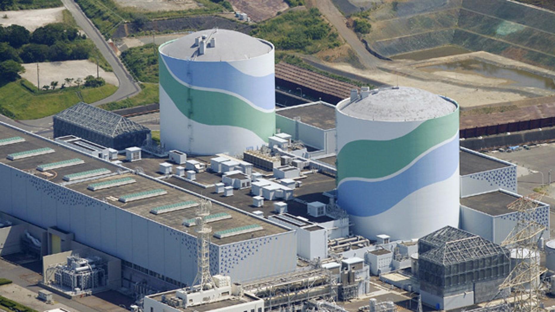 Aug. 11, 2015: This aerial photo shows reactors of No. 1, right, and No. 2, left,  at the Sendai Nuclear Power Station in Satsumasendai, Kagoshima prefecture, southern Japan. (Kyodo News via AP)