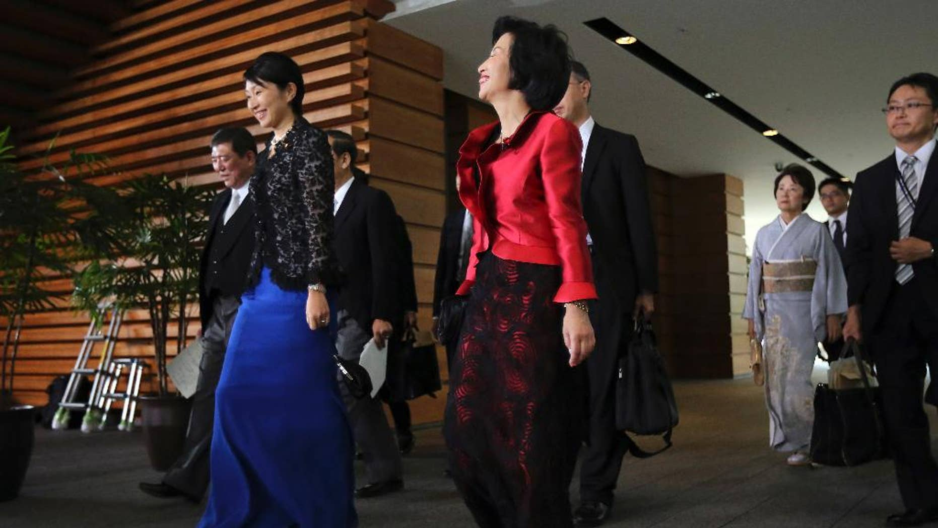 Midori Matsushima, center, newly appointed minister of Justice, Yuko Obuchi, 2nd left, newly appointed minister of Trade and Economy, and Eriko Yamatani, 3rd right, newly appointed minister in charge of abduction issue, leave for the attestation ceremony at the Imperial Palace at the prime minister's official residence in Tokyo Wednesday, Sept. 3, 2014. (AP Photo/Eugene Hoshiko)
