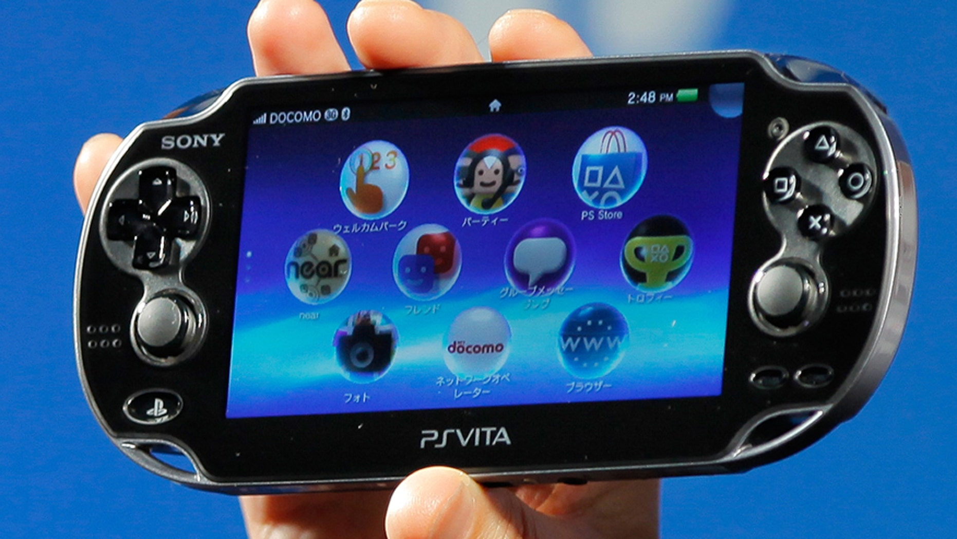 In this Sept. 14, 2011 file photo, Sony Computer Entertainment's PlayStation Vita is shown during a press conference in Tokyo.