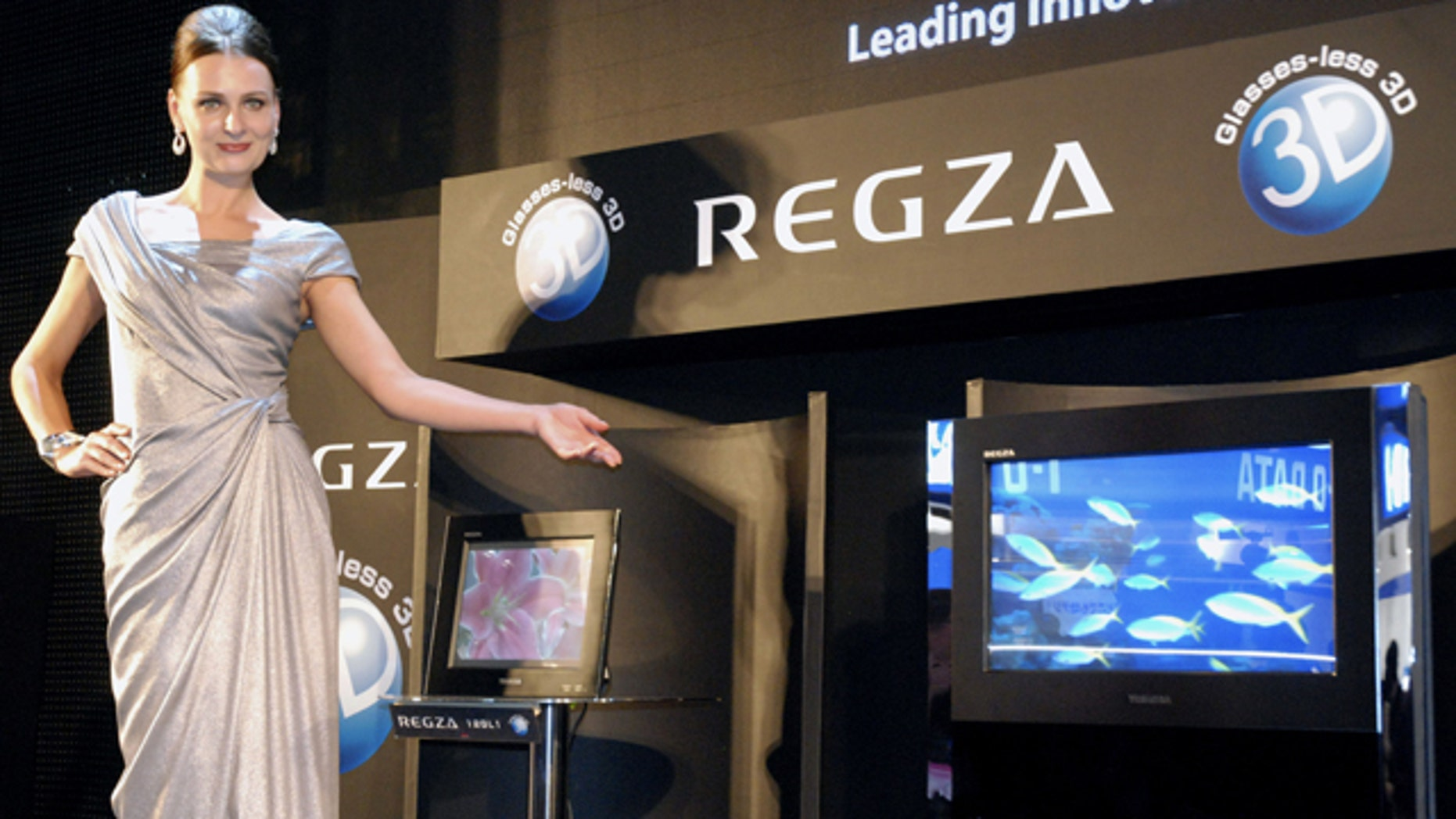 A model shows Toshiba Corp.'s world's first high definition liquid crystal display 3-D television in Chiba, east of Tokyo, Monday, Oct. 4, 2010. The new 3-D TV does not require special glasses, one of the biggest consumer complaints about the technology.