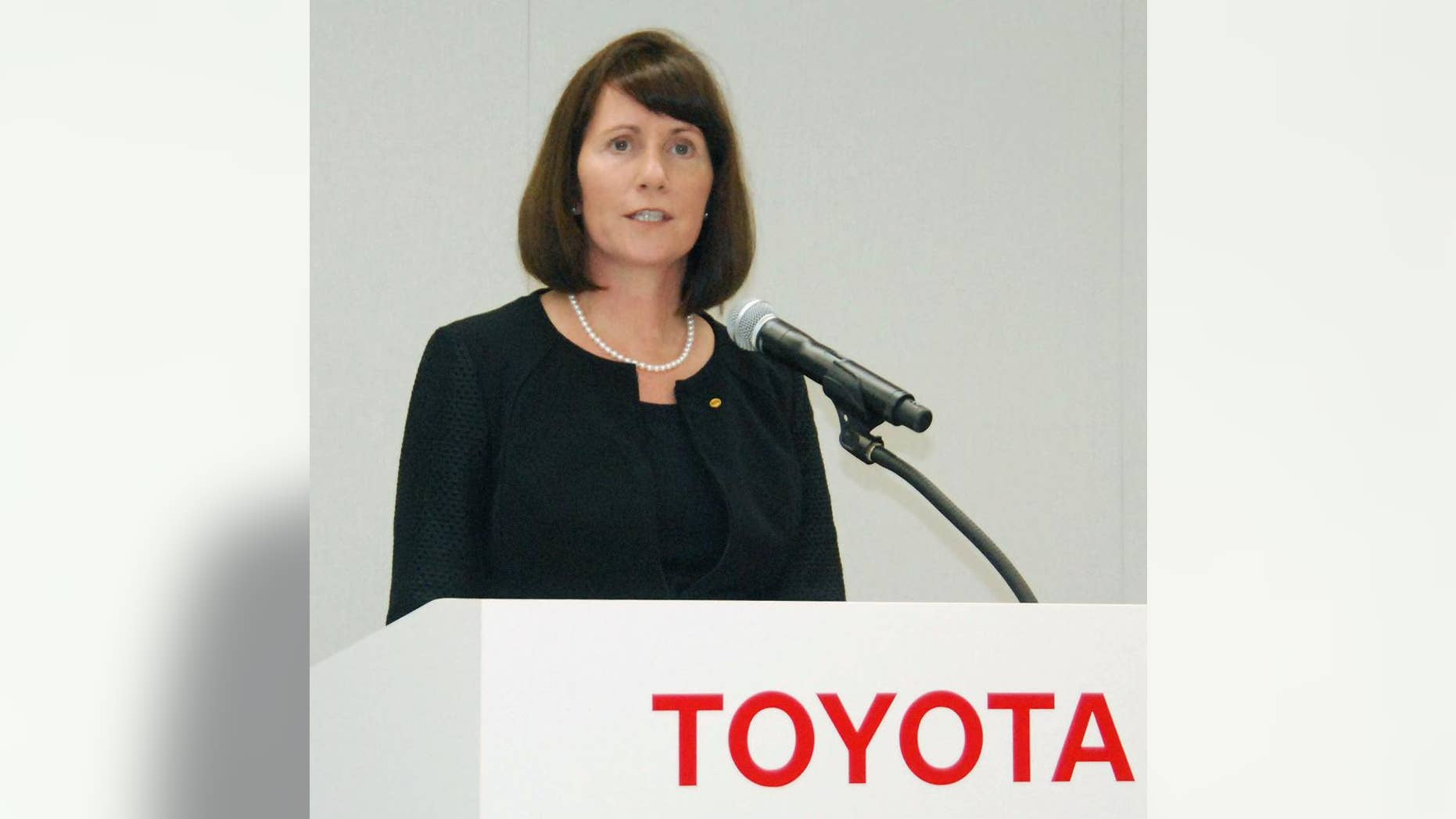 FILE - In this July 17, 2015 file photo, Toyota Motor Corp.'s head of public relations Julie Hamp speaks during a press conference in Toyota, central Japan.  Toyota said Wednesday, July 1, 2015, the US executive arrested in Japan on suspicion of drug law violations has resigned. (Tsutomu Agechi/Kyodo News via AP, File) JAPAN OUT, CREDIT MANDATORY