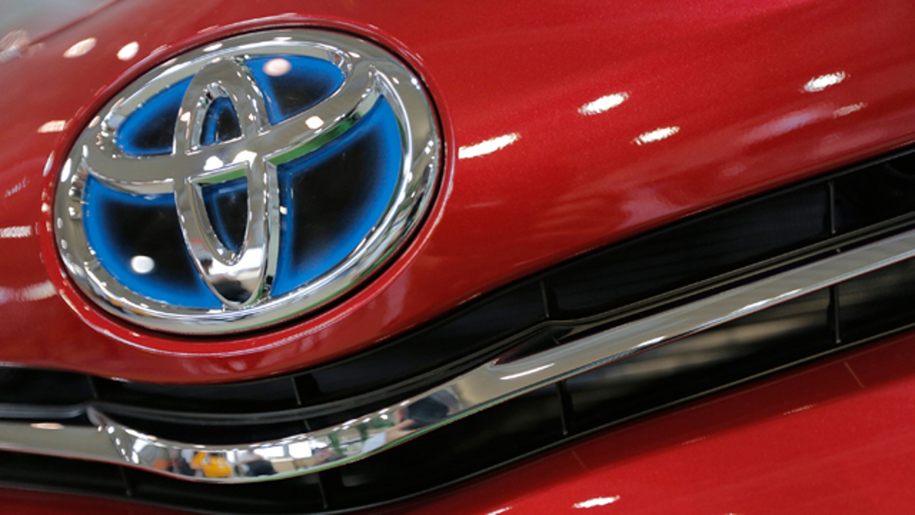 August 2, 2013: The emblem of a Toyota car shines at Toyota Motor Corp.'s showroom Toyota Mega Web in Tokyo. (AP Photo/Itsuo Inouye, File)