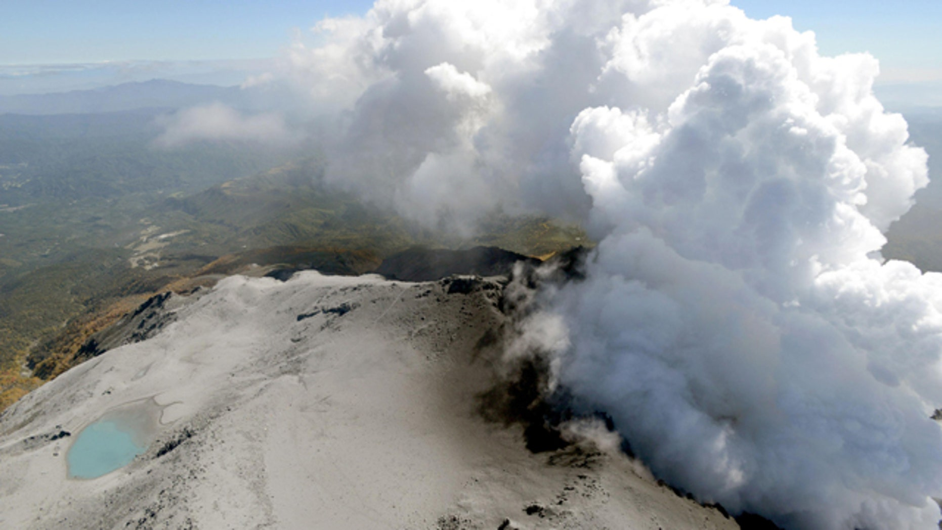 September 30, 2014: An aerial view shows volcanic smoke and fumes rising from the craters of Mount Ontake, central Japan. (AP Photo/Kyodo News)