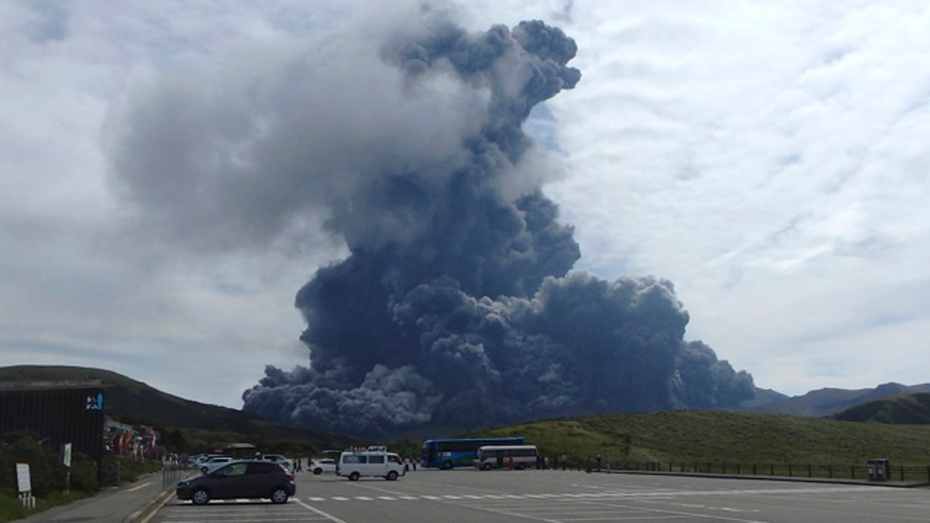 Sept. 14, 2015: In this photo released by Aso Volcano Museum, a column of black smoke rises from Mount Aso on the southern Japanese island of Kyushu. (Aso Volcano Museum via AP)