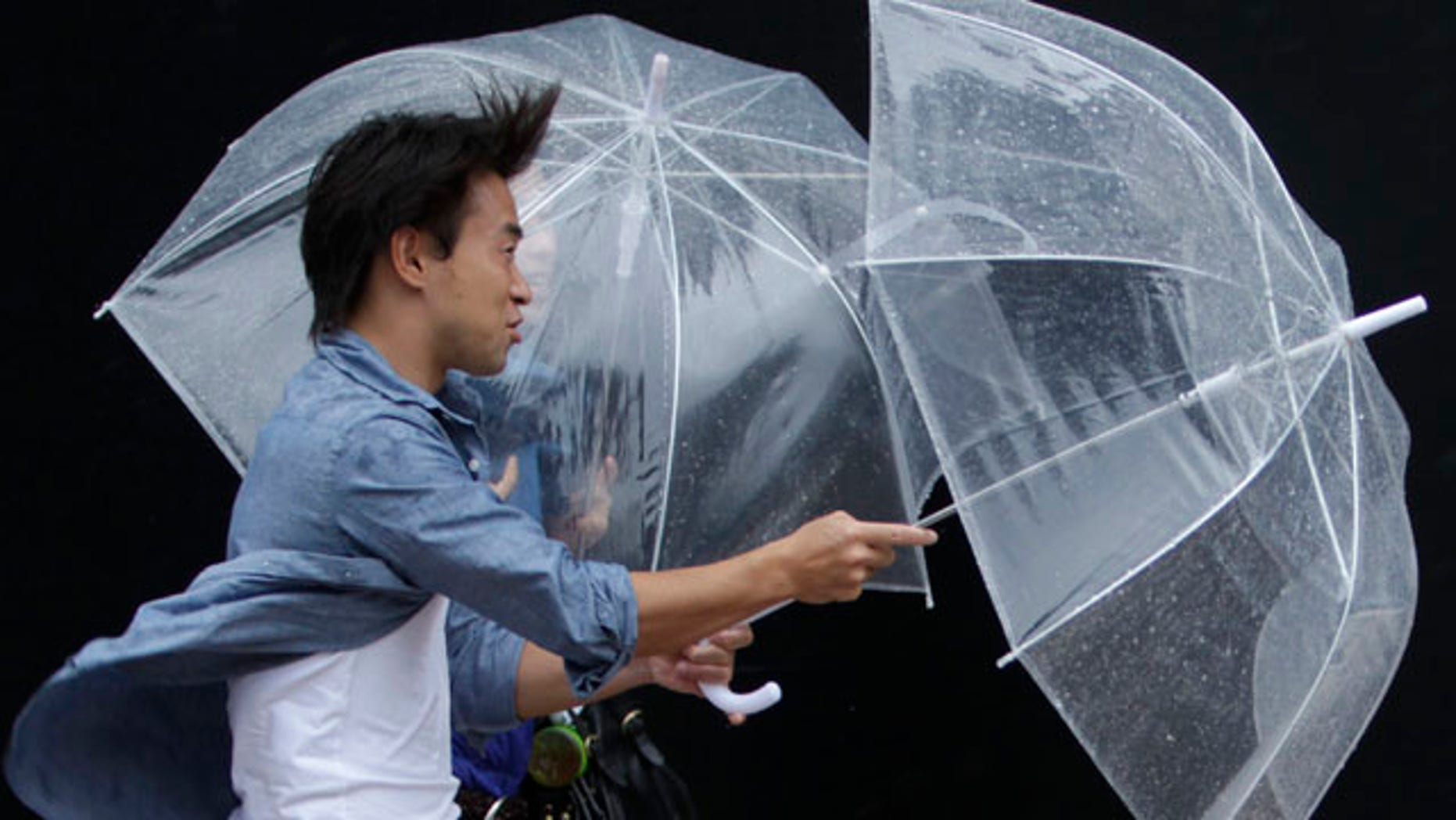 Sept. 21: A man makes their way through strong winds and rains from Typhoon Roke in Tokyo.