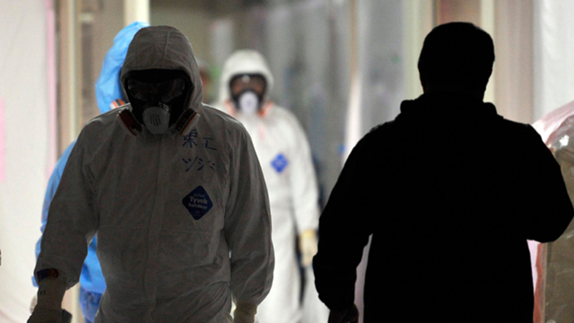 Feb. 28: Workers at the emergency operation center of the stricken Fukushima Dai-ichi nuclear power plant of Tokyo Electric Power Co.,  in Okuma town,  Fukushima prefecture, northeastern Japan.