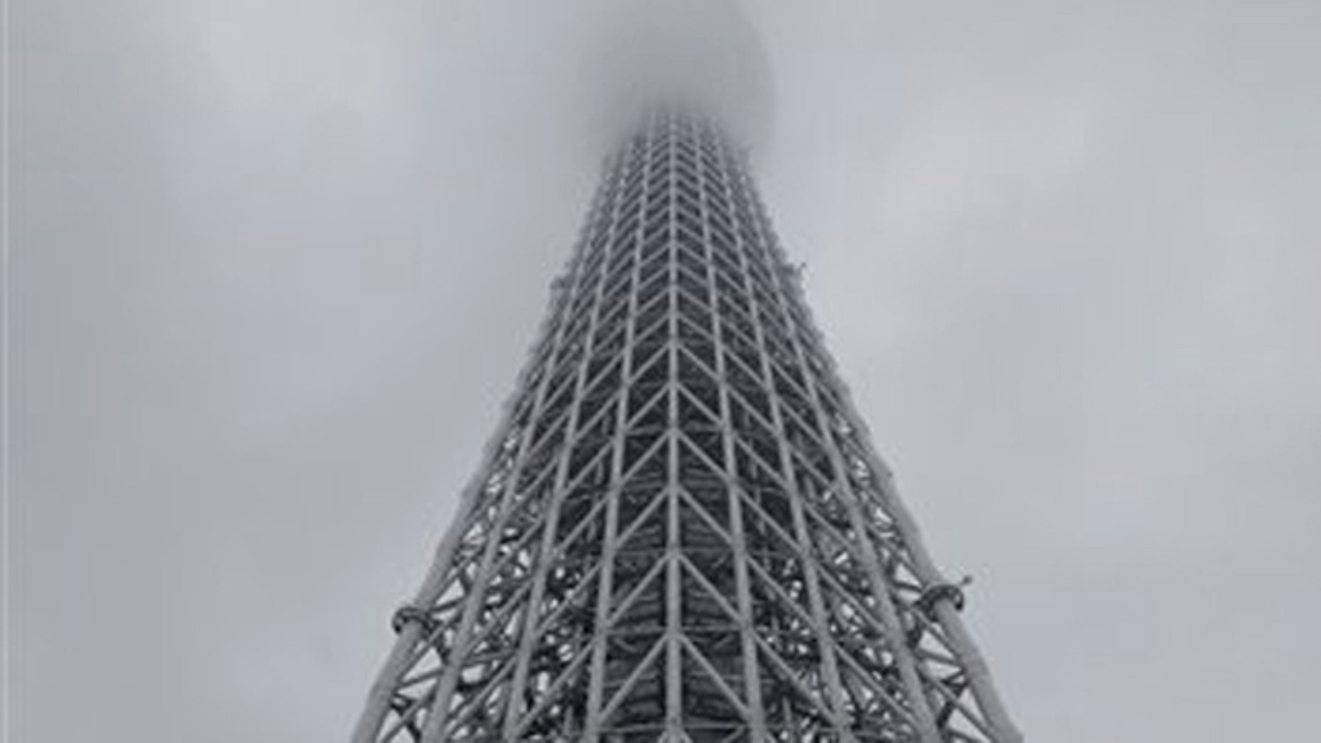 May 22, 2012: Visitors wait in front of the entrance of the Tokyo Skytree in Tokyo.