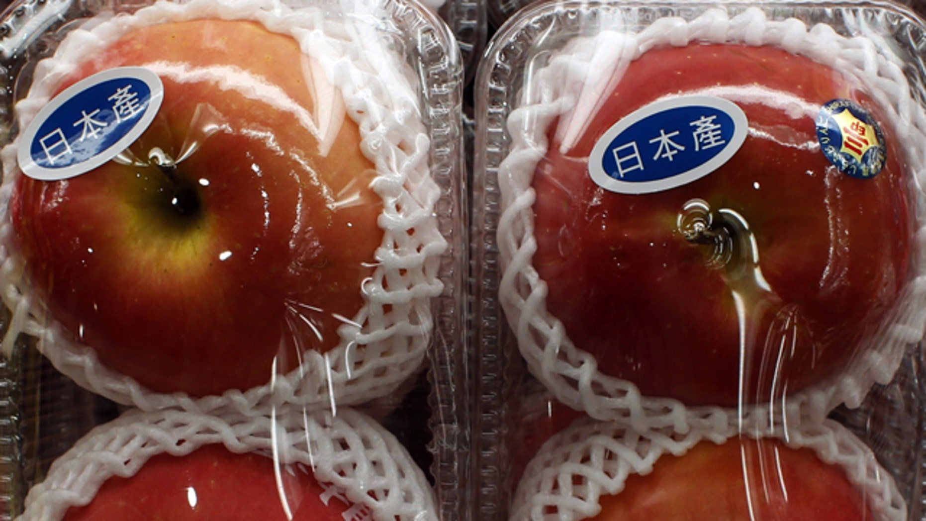 """Apples with """"Produced in Japan"""" stickers are seen at a Japanese supermarket in Hong Kong March 21, 2011. The World Health Organization said on Monday that the detection of radiation in food after an earthquake damaged a Japanese nuclear plant was a more serious problem than it had first expected. The Hong Kong Government on Monday has given assurances that the territory's food and water supplies have not been contaminated with radiation from Japan, according to local media."""