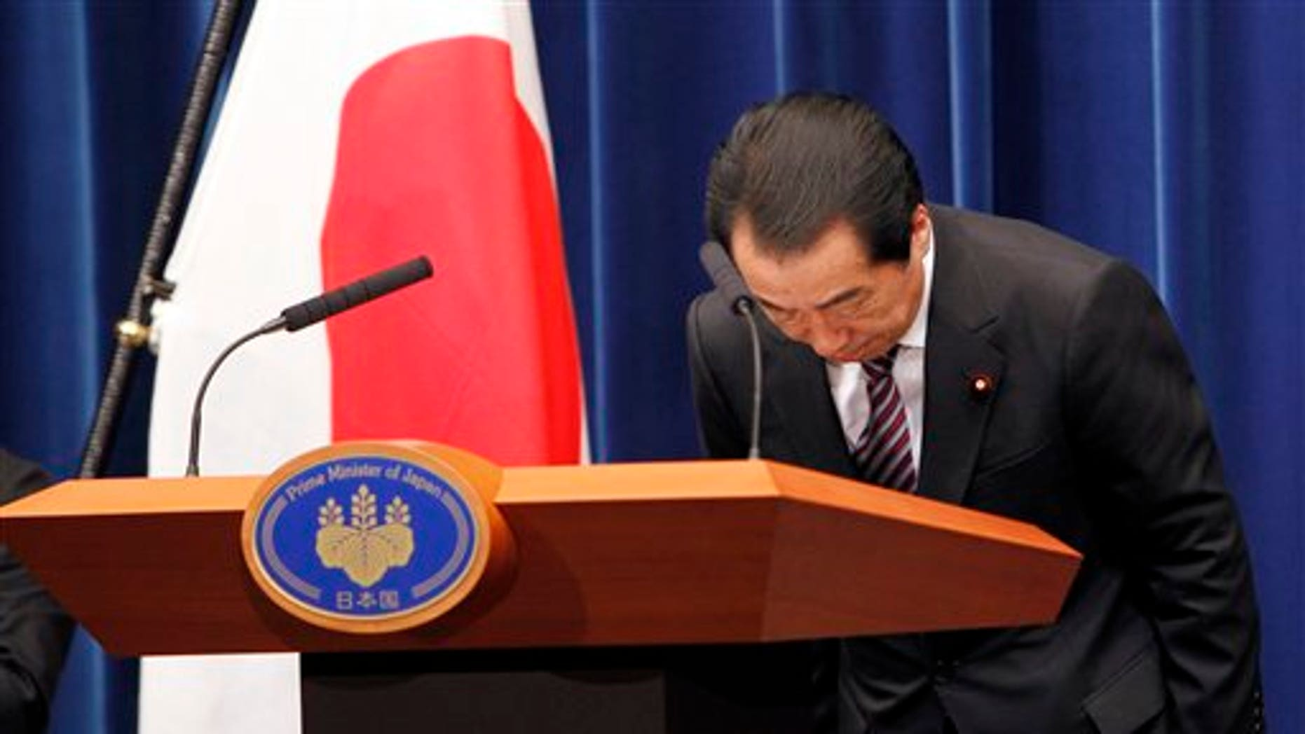 August 26: Japanese Prime Minister Naoto Kan bows during a press conference at his official residence in Tokyo, Japan.