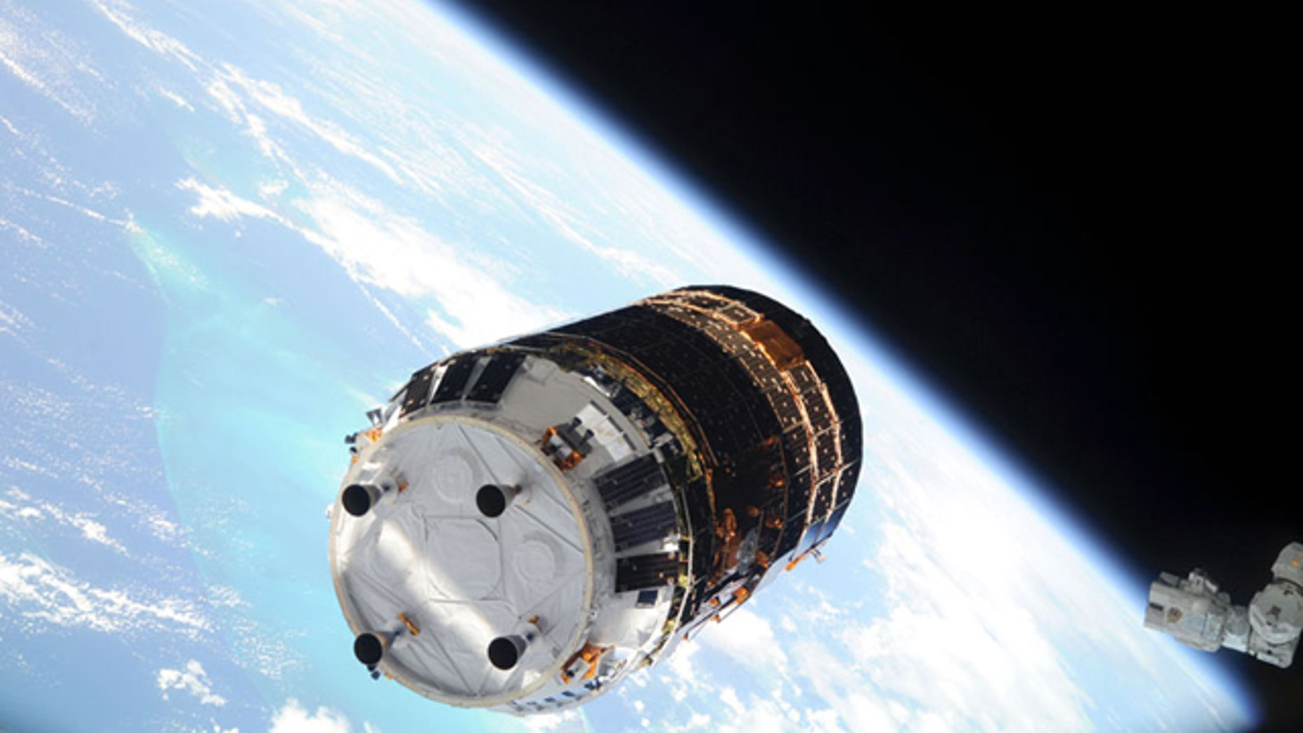 Backdropped by Earth's horizon and the blackness of space, the first unpiloted Japanese H-2 Transfer Vehicle (HTV) approaches the International Space Station on Sept. 17, 2009.