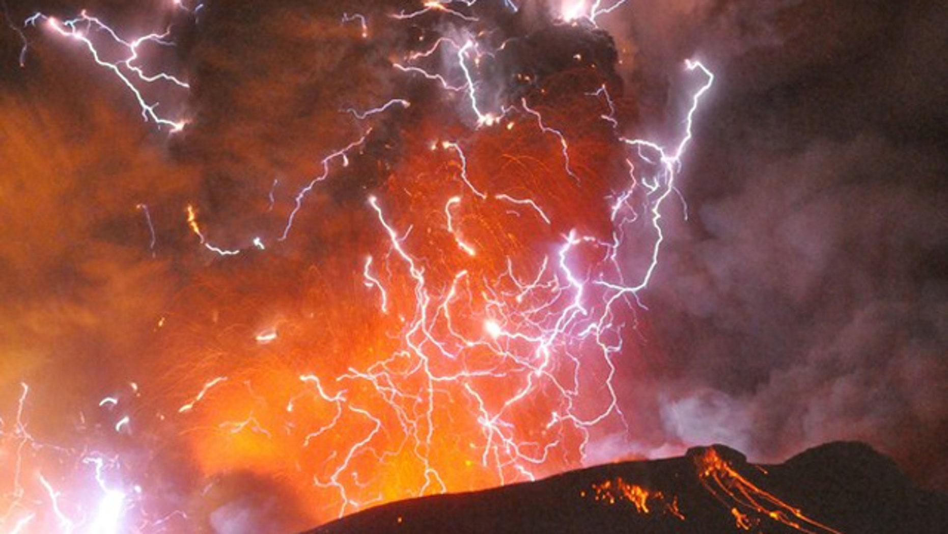 Jan. 28: Volcanic lightning or a dirty thunderstorm is seen above Shinmoedake peak as it erupts, between Miyazaki and Kagoshima prefectures, in this photo taken from Kirishima city and released by Minami-Nippon Shimbun.