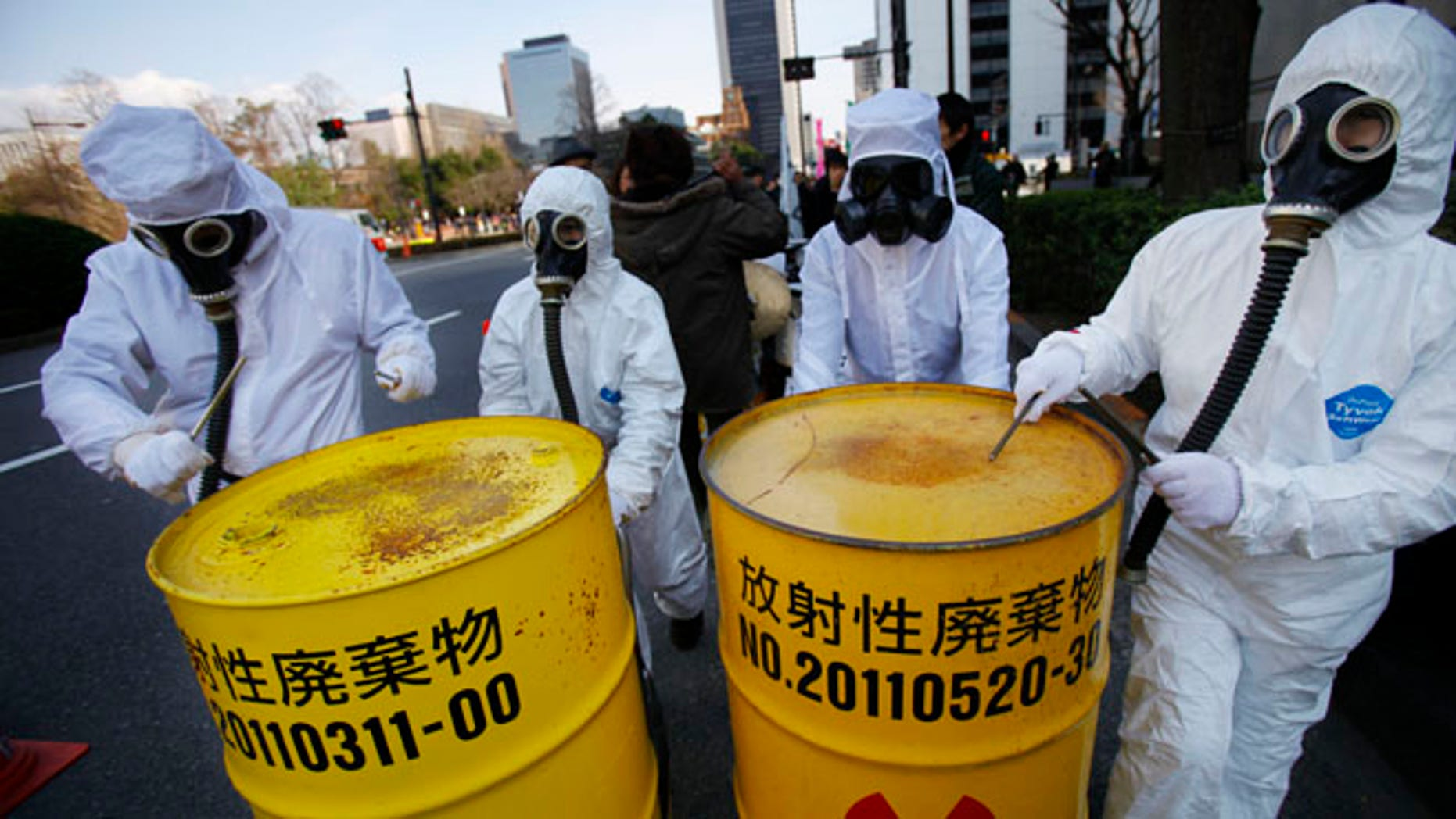 March 9, 2014: Costumed protesters beat drum cans during an anti-nuclear plant demonstration in Tokyo.