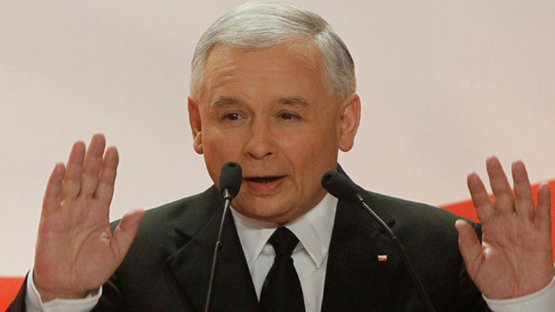 June 20: Jaroslaw Kaczynski, presidential candidate of Poland's Law and Justice Party speaks at his party election headquarters for his supporters after acknowledging exit polls for the early Presidential elections in Warsaw, Poland. (AP)