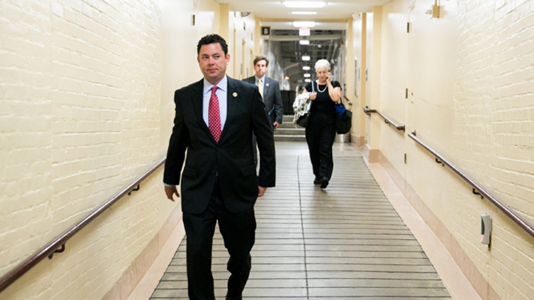 WASHINGTON, DC - JULY 9:  U.S. Rep. Jason Chaffetz (R-UT) makes his way to a House GOP caucus meeting, on Capitol Hill, July 9, 2013 in Washington, DC. The Republican leadership discussed the immigration bill and the Obama administration's decision to delay a portion of the Affordable Care Act, which will extend the deadline for employer mandated health care to 2015. At right, Trey Radel (R-FL) and House Majority Leader Eric Cantor (R-VA) look on. (Photo by Drew Angerer/Getty Images)