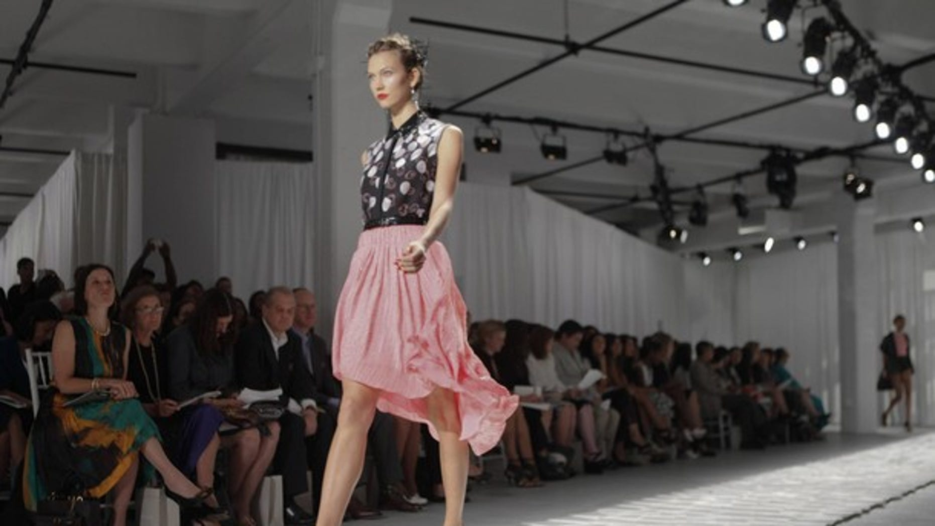 A model walks the runway at the Spring 2012 Jason Wu show. Wu will reportedly design a line for Target. (Reuters)