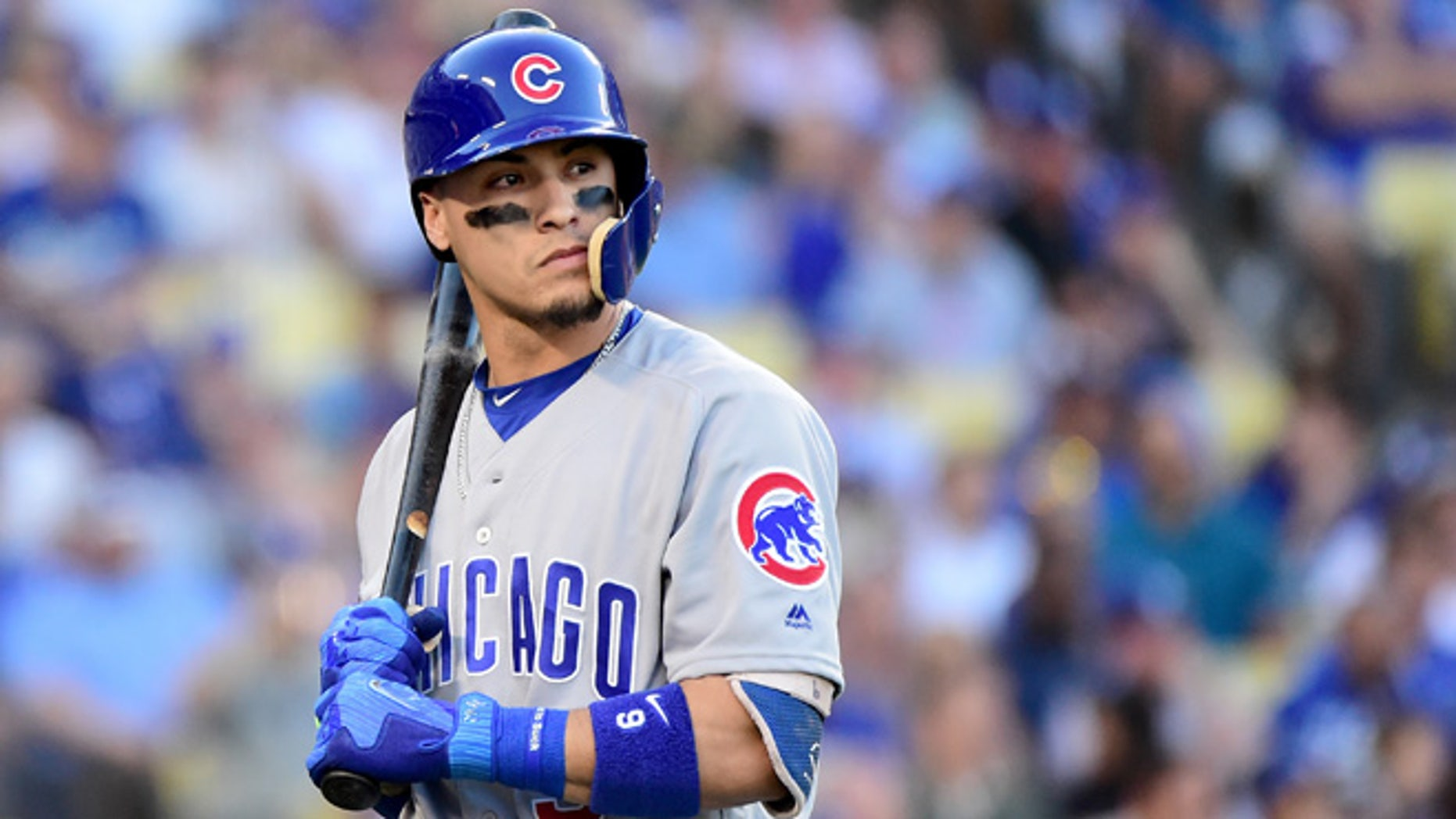 LOS ANGELES, CA - OCTOBER 20: Javier Baez #9 of the Chicago Cubs reacts after striking out in the first inning in game five of the National League Division Series at Dodger Stadium on October 20, 2016 in Los Angeles, California.  (Photo by Harry How/Getty Images)