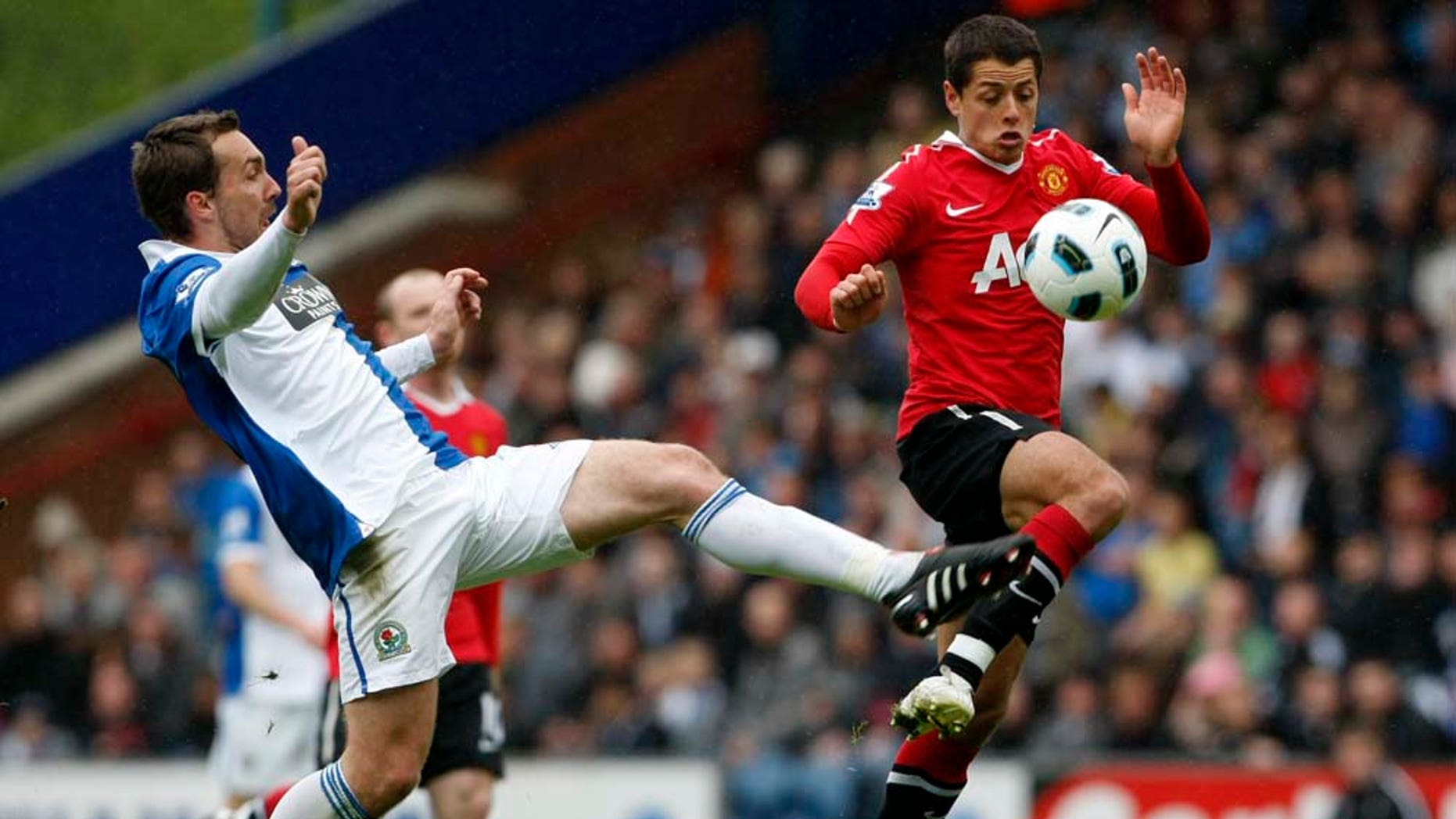Manchester United's Javier Hernandez, right, vies for the ball against Blackburn's Gael Givet during their English Premier League soccer match at Ewood Park, Blackburn, England, Saturday May 14, 2011. (AP Photo/Tim Hales)  NO INTERNET/MOBILE USAGE WITHOUT FOOTBALL ASSOCIATION PREMIER LEAGUE (FAPL) LICENCE. CALL +44 (0) 20 7864 9121 or EMAIL info@football-dataco.com FOR DETAILS
