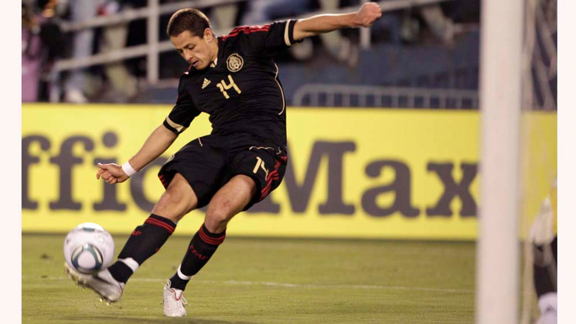 Mexico's Javier Hernandez misses a shot on goal at close range against Venezuela in the first half during an international friendly soccer match Tuesday, March 29, 2011, in San Diego. (AP Photo/Gregory Bull)