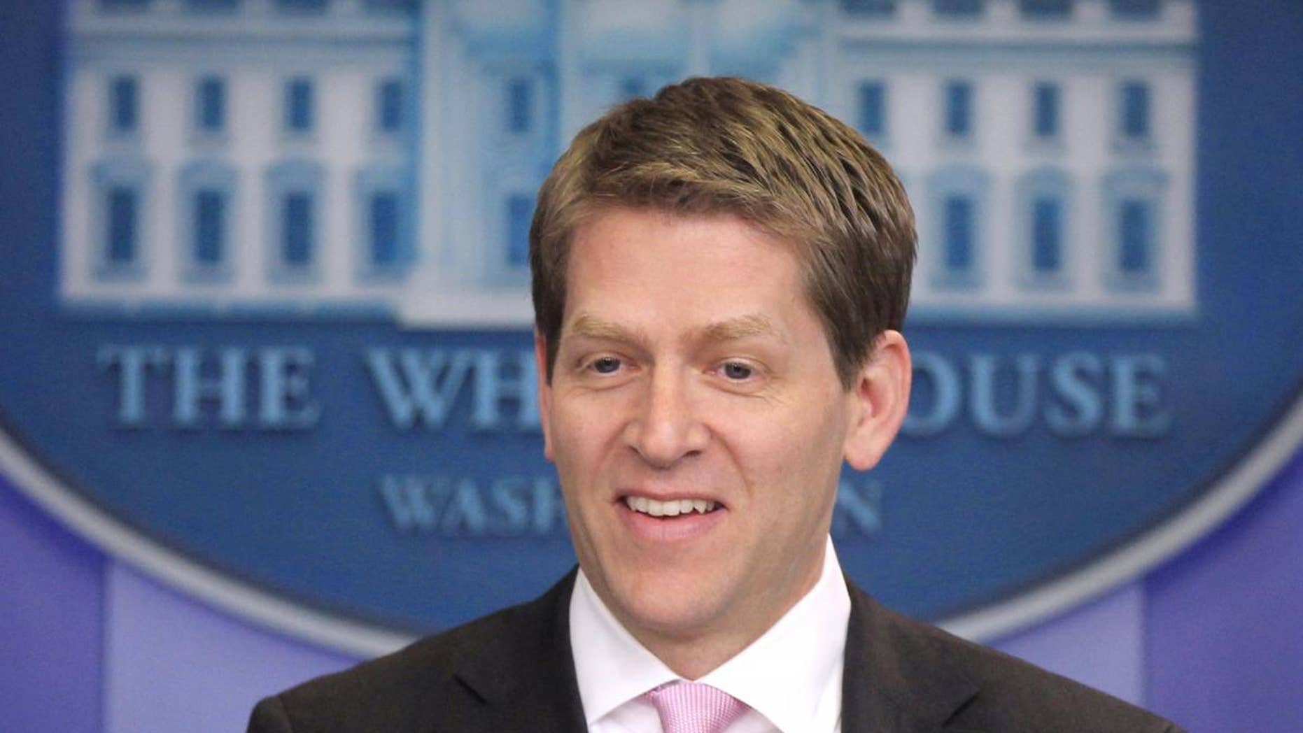 White House Press Secretary Jay Carney briefs reporters at the White House in Washington, Friday, April 1, 2011. (AP Photo/Charles Dharapak)