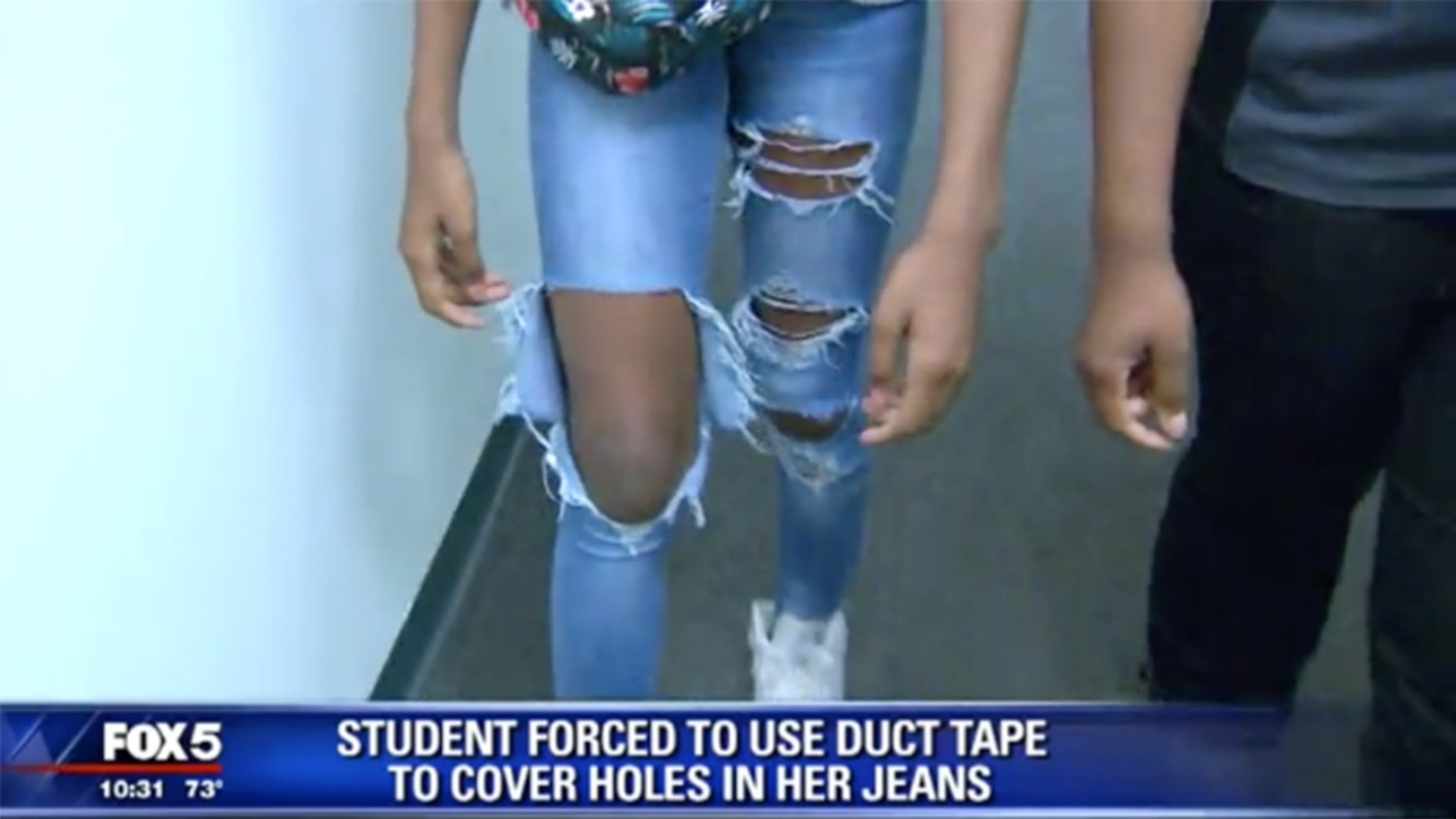 A teacher gave a seventh grade duct tape to cover the holes in her jeans, which violated the school's dress code.