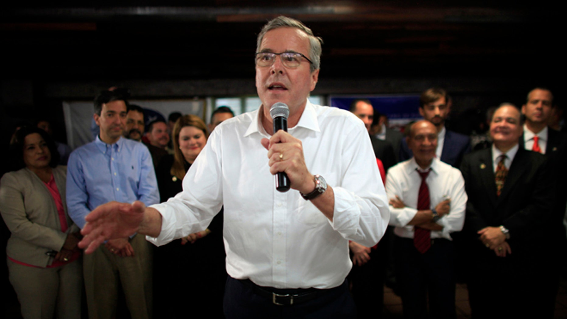 FILE - In this April 28, 2015 file photo, former Florida Gov. Jeb Bush speaks during a town hall meeting with Puerto Rico's Republican Party in Bayamon, Puerto Rico. Bush on Wednesday declared that 11 million immigrants in the country illegally should have an opportunity to stay, wading into the explosive immigration debate for the second time in two days while courting Hispanic voters. (AP Photo/Ricardo Arduengo, File)