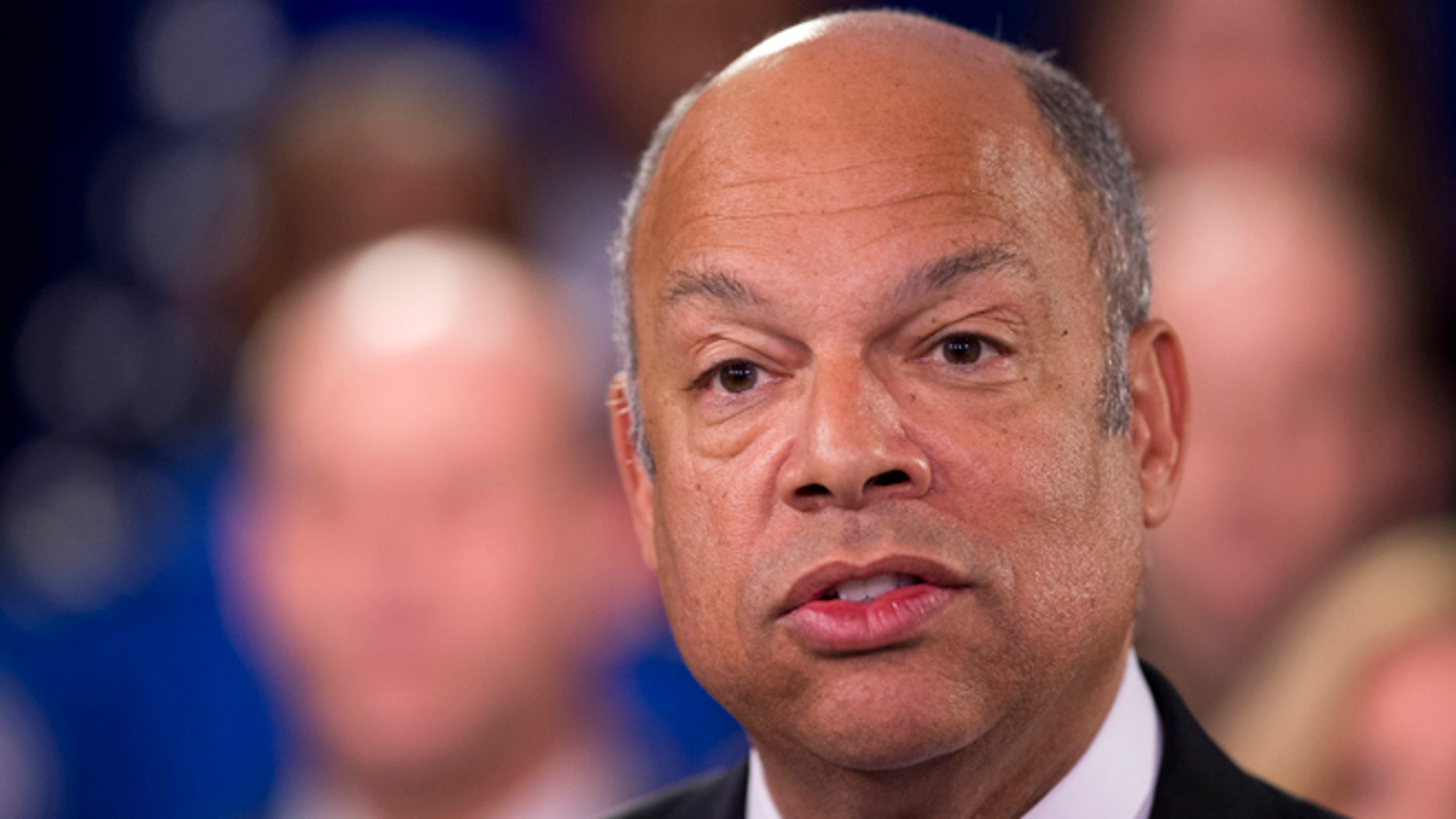 Homeland Security Secretary Jeh Johnson, joined by the department employees, during a news conference in Washington, Monday, Feb. 23, 2015. A partial shutdown of the Homeland Security Department loomed at weekâs end, but no solution was in sight as senators returned to the Capitol from a week-long recess Monday to confront an impasse over the issue.    (AP Photo/Manuel Balce Ceneta)