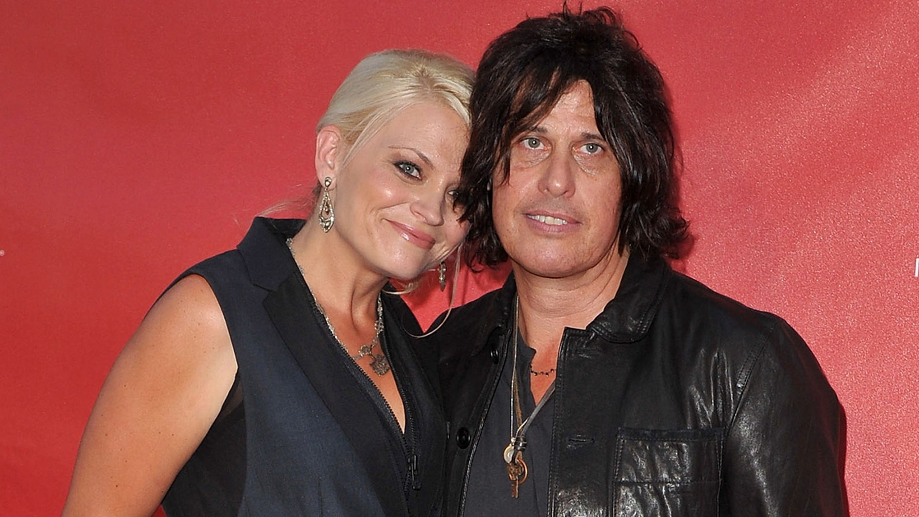 Jenn DeLeo claims husband Dean began abusing drugs and alcohol shortly after she gave birth to their daughter in 2012. The photo above shows the couple arriving at the 9th Annual MusiCares MAP Fund Benefit Concert on May 30, 2013 in Los Angeles.