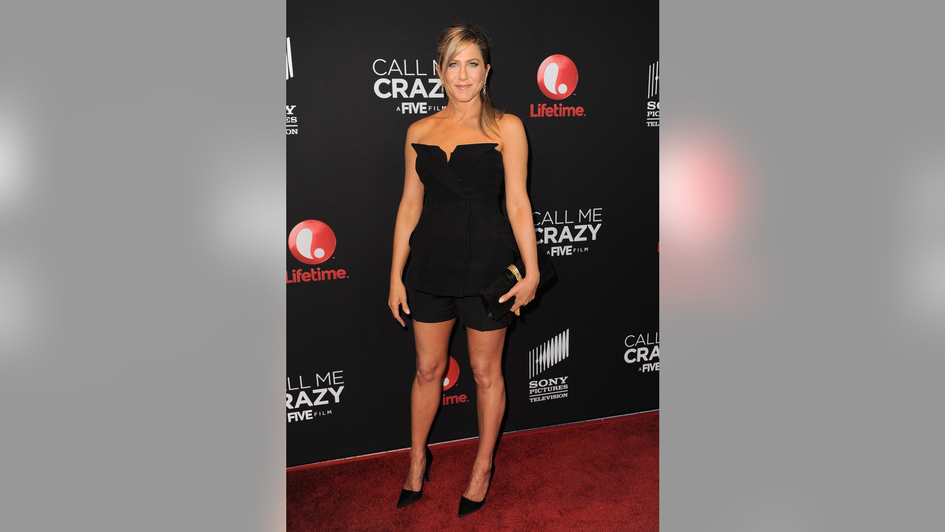 """Jennifer Aniston arrives at the world premiere of """"Call Me Crazy: A Five Film"""" at the Pacific Design Center on Tuesday, April 16, 2013 in Los Angeles."""