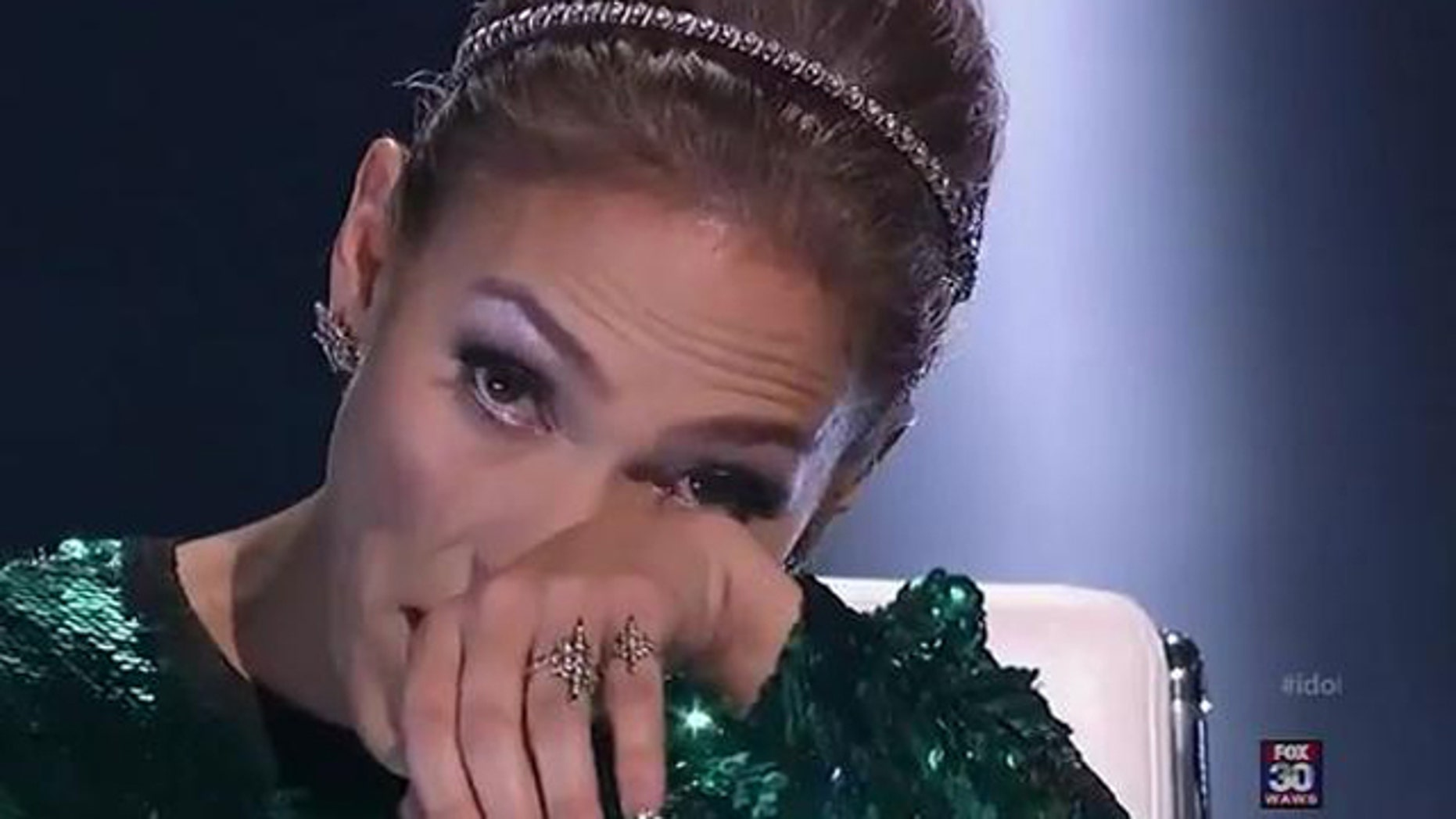 Feb. 23, 2012: Jennifer Lopez wipes tears as she tells American Idol contestant Jermaine Jones he did not make it to the top 24.