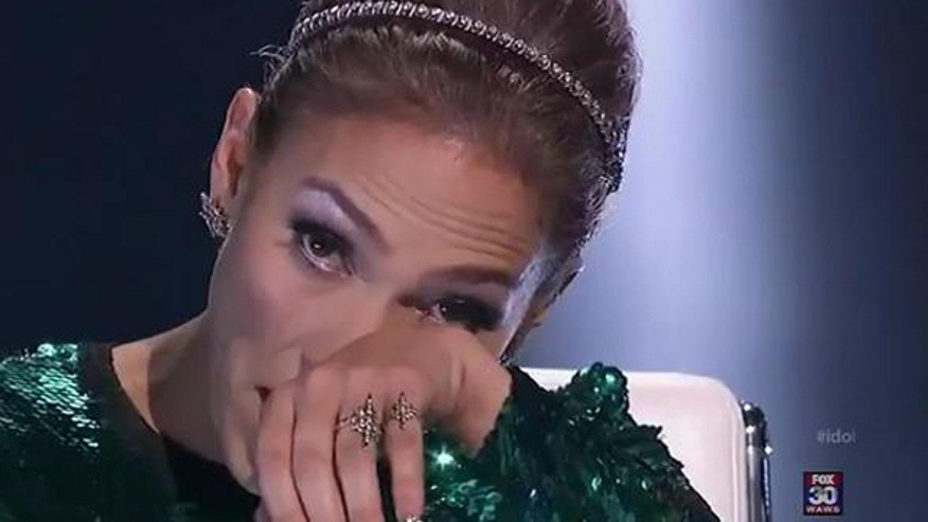 Feb. 23, 2012: Jennifer Lopez wipes tears as she tells American Idol contestant Jermaine Jones he did not make it to the top 24.