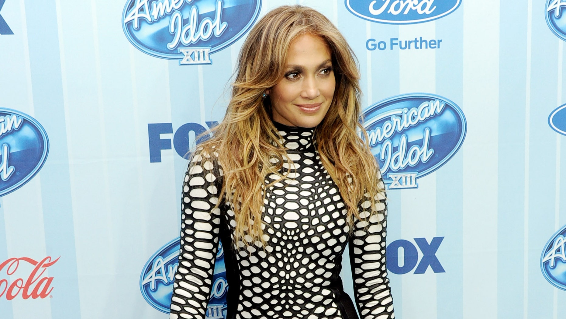 """LOS ANGELES, CA - JANUARY 14:  Singer Jennifer Lopez arrives at the premiere of Fox's """"American Idol Xlll"""" at UCLA's Royce Hall on January 14, 2014 in Los Angeles, California.  (Photo by Kevin Winter/Getty Images)"""