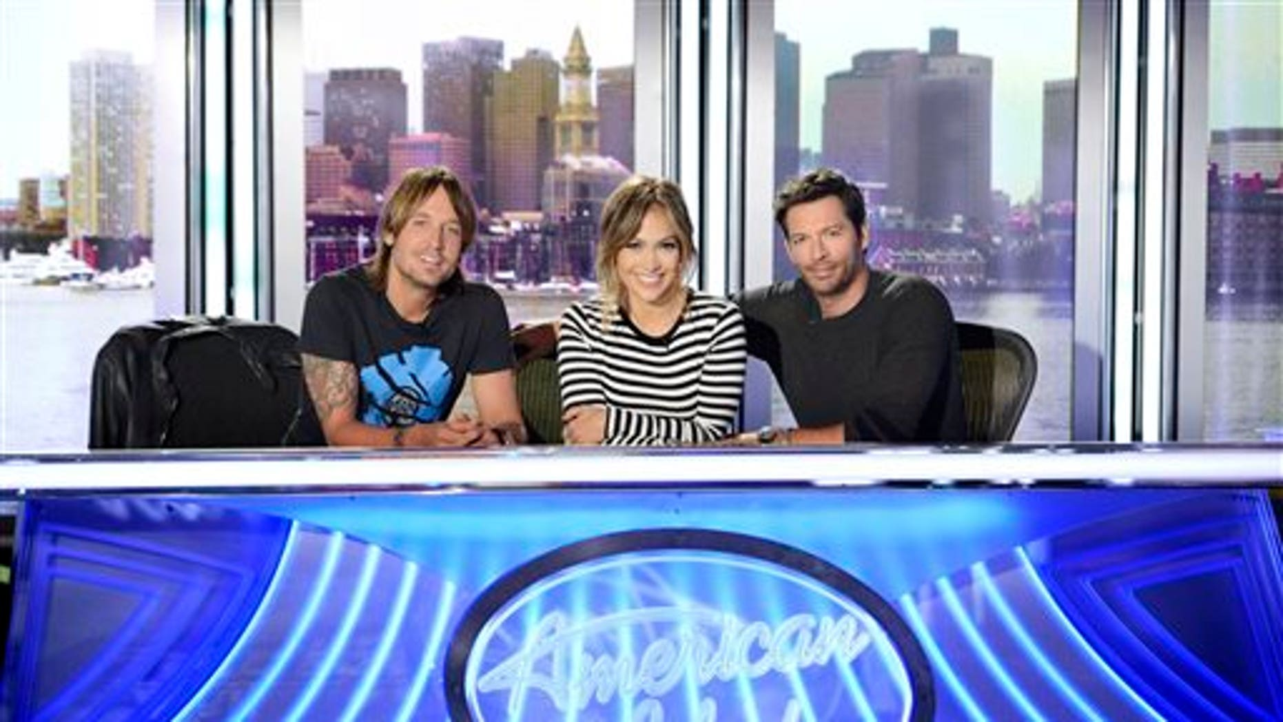 """FILE - This 2013 file publicity photo released by FOX shows American Idol XIII judges, from left, Keith Urban, Jennifer Lopez and Harry Connick Jr. One thing about season 13 of """"American Idol"""" is that unlike last season, the judges seem to be getting along. (AP Photo/FOX, Michael Becker)"""
