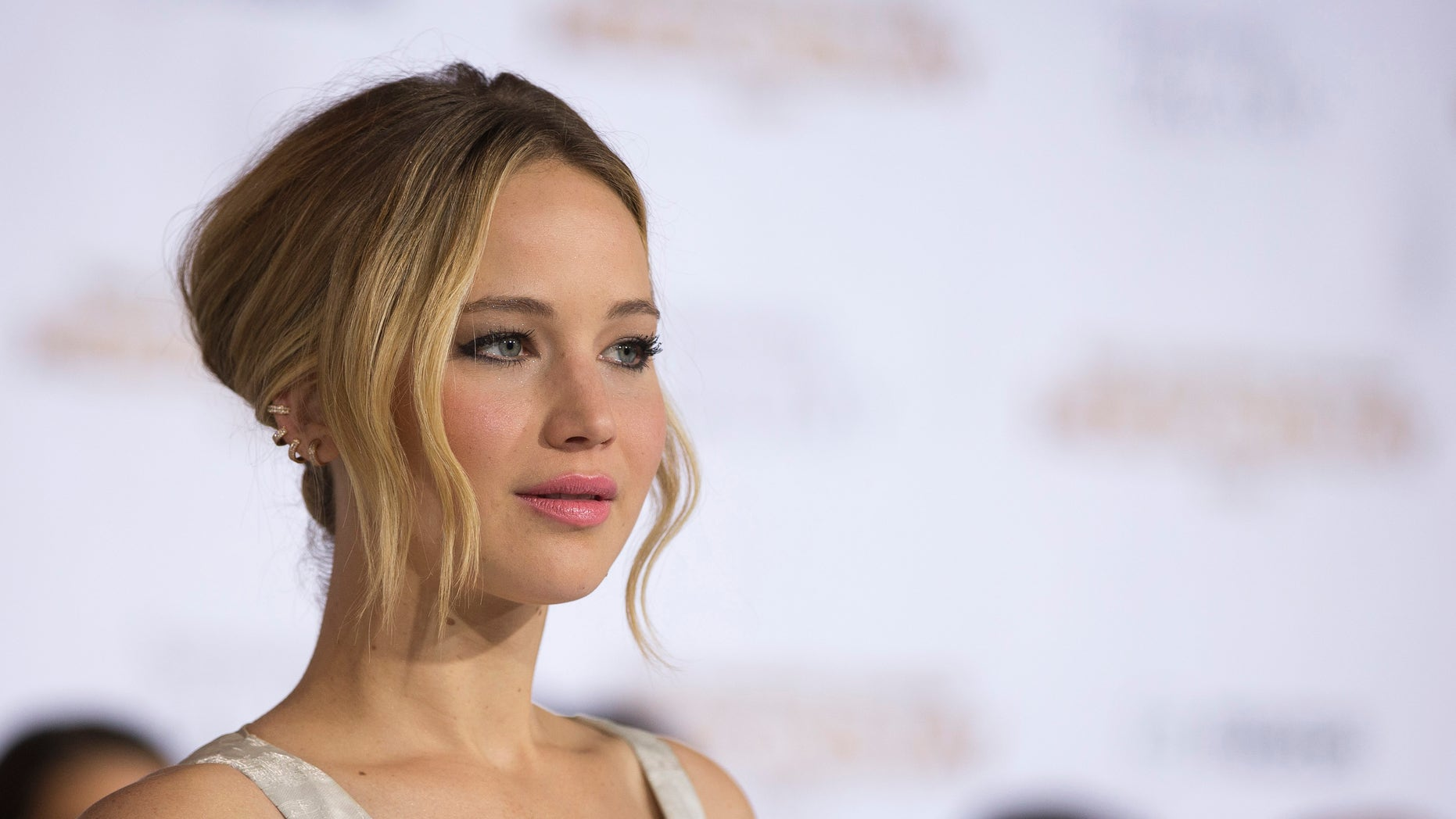 """November 17, 2014. Cast member Jennifer Lawrence poses at the premiere of """"The Hunger Games: Mockingjay - Part 1"""" in Los Angeles."""