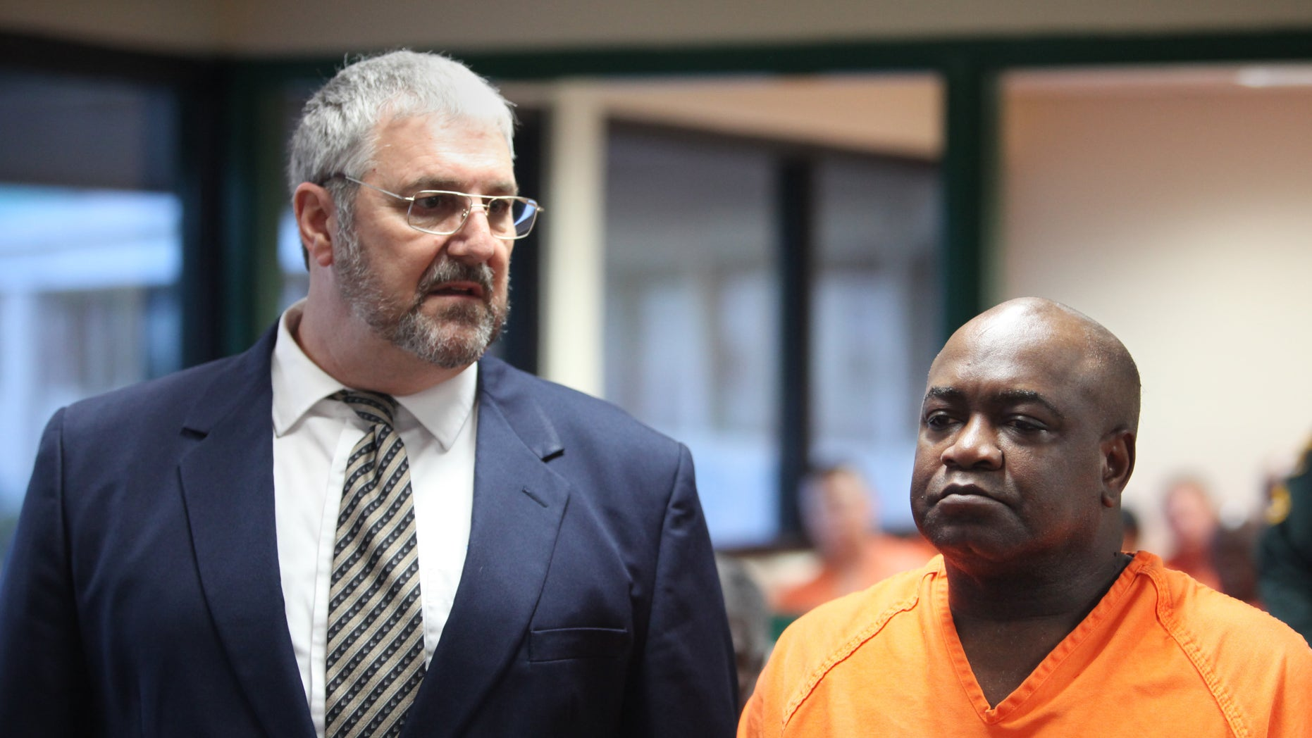 September 19: Assistant Public Defender Robert Trogolo, left, stands next to Jeremiah Fogle, 57, during Fogle's first appearance in front of County Judge Susan Barber Flood, in Bartow, Florida. Fogle has been charged with first-degree murder of his wife Theresa Fogle, 56, and three counts of attempted murder and shooting into an occupied dwelling.