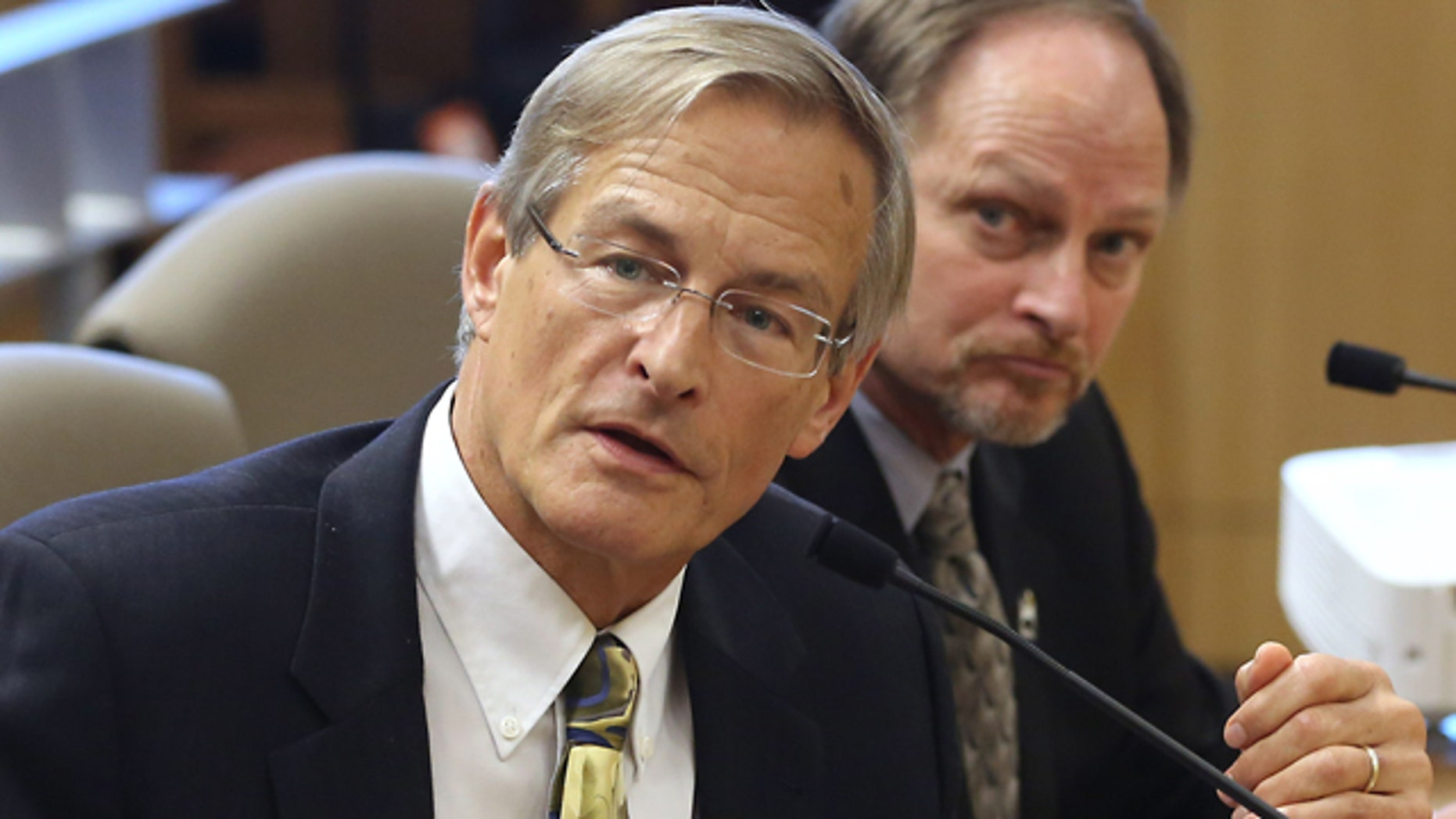FILE - In this March 10, 2015, file photo, Steven Bohlen, left, then Gas Supervisor for the Conservation Departments Division of Oil, Gas and Geothermal Resources answers a question during a joint hearing of the Senate Natural Resources and Water and Environmental Quality Committees at the Capitol in Sacramento, Calif. (AP Photo/Rich Pedroncelli, File)
