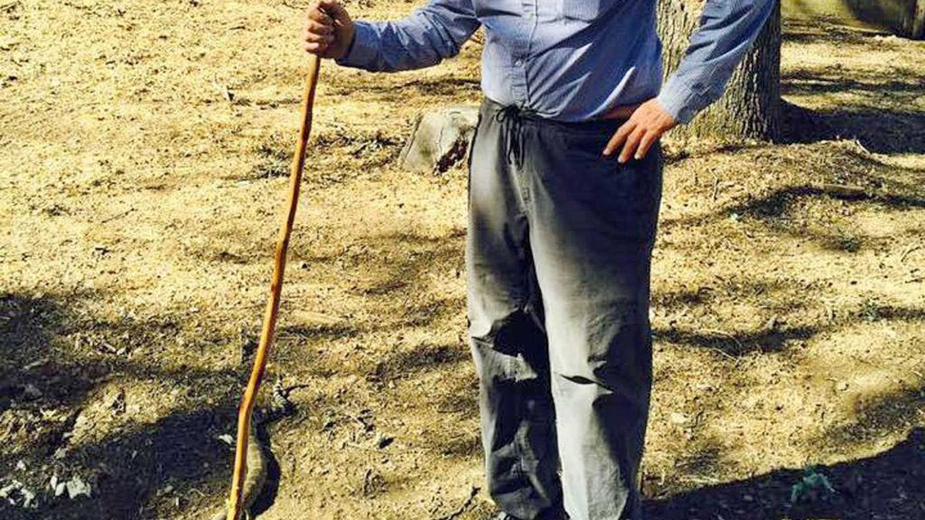 In this undated photo taken by California first lady Anne Gust and posted to Gov. Jerry Brown's Twitter account on Saturday, April 18, 2015, California Gov. Jerry Brown poses with a rattlesnake, held with a snake stick, on land Brown's family owns in rural Colusa county, near Williams, Calif.  (Anne Gust via AP)
