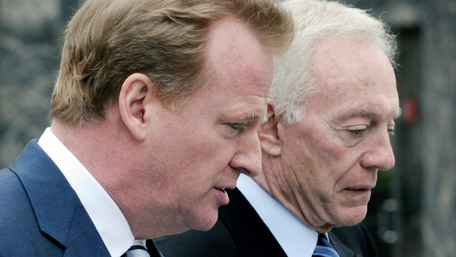 NFL Commissioner Roger Goodell, left, chats with Dallas Cowboys' owner Jerry Jones as they arrive at the federal courthouse Tuesday, April 19, 2011 in Minneapolis where the NFL and its locked-out football players continue court-ordered mediation.  (AP Photo/Jim Mone)