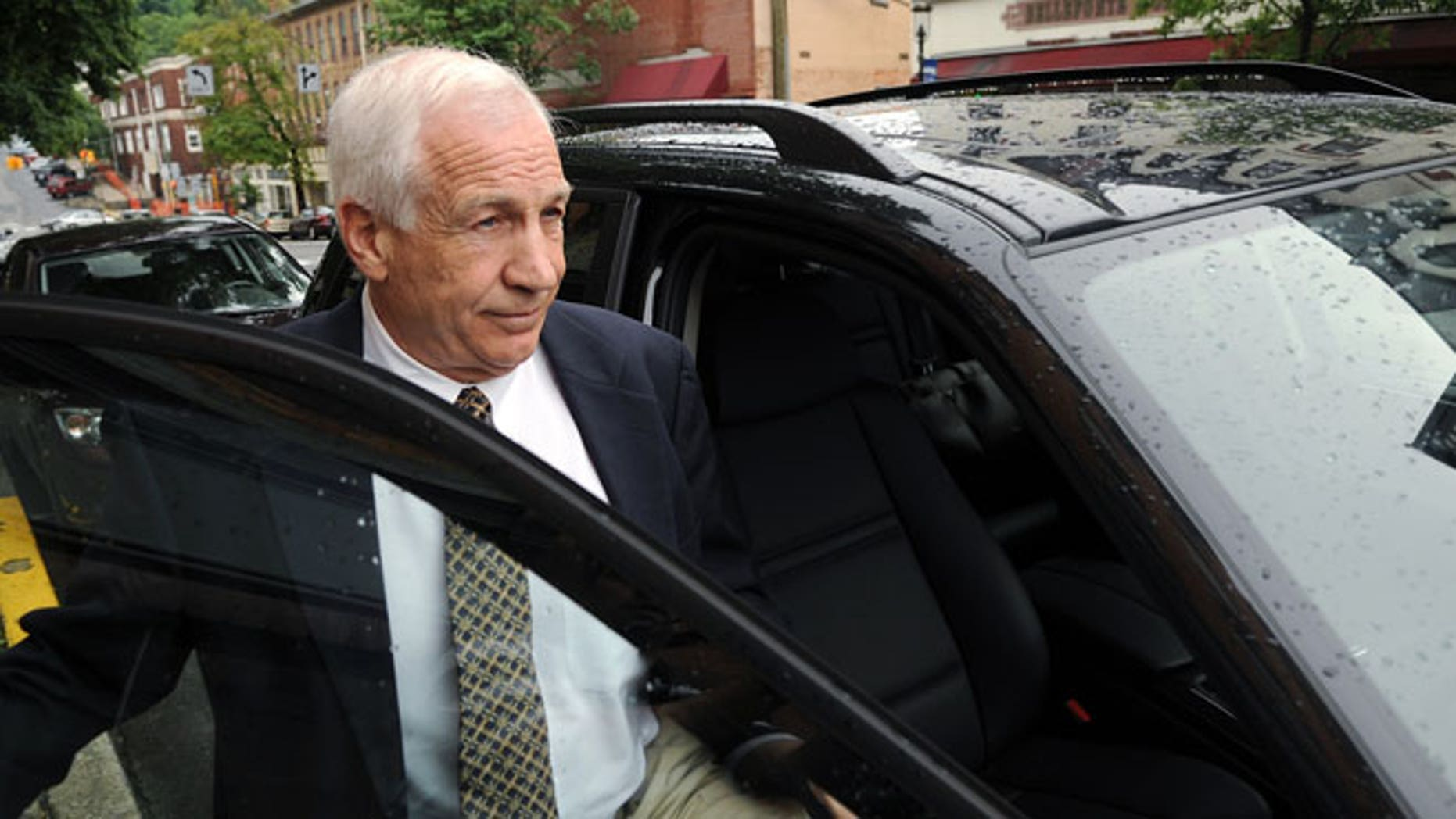In a Tuesday, May 29, 2012 file photo, Jerry Sandusky gets into his attorney Joe Amendola's car near the Centre County Courthouse Annex in Bellefonte, Pa.