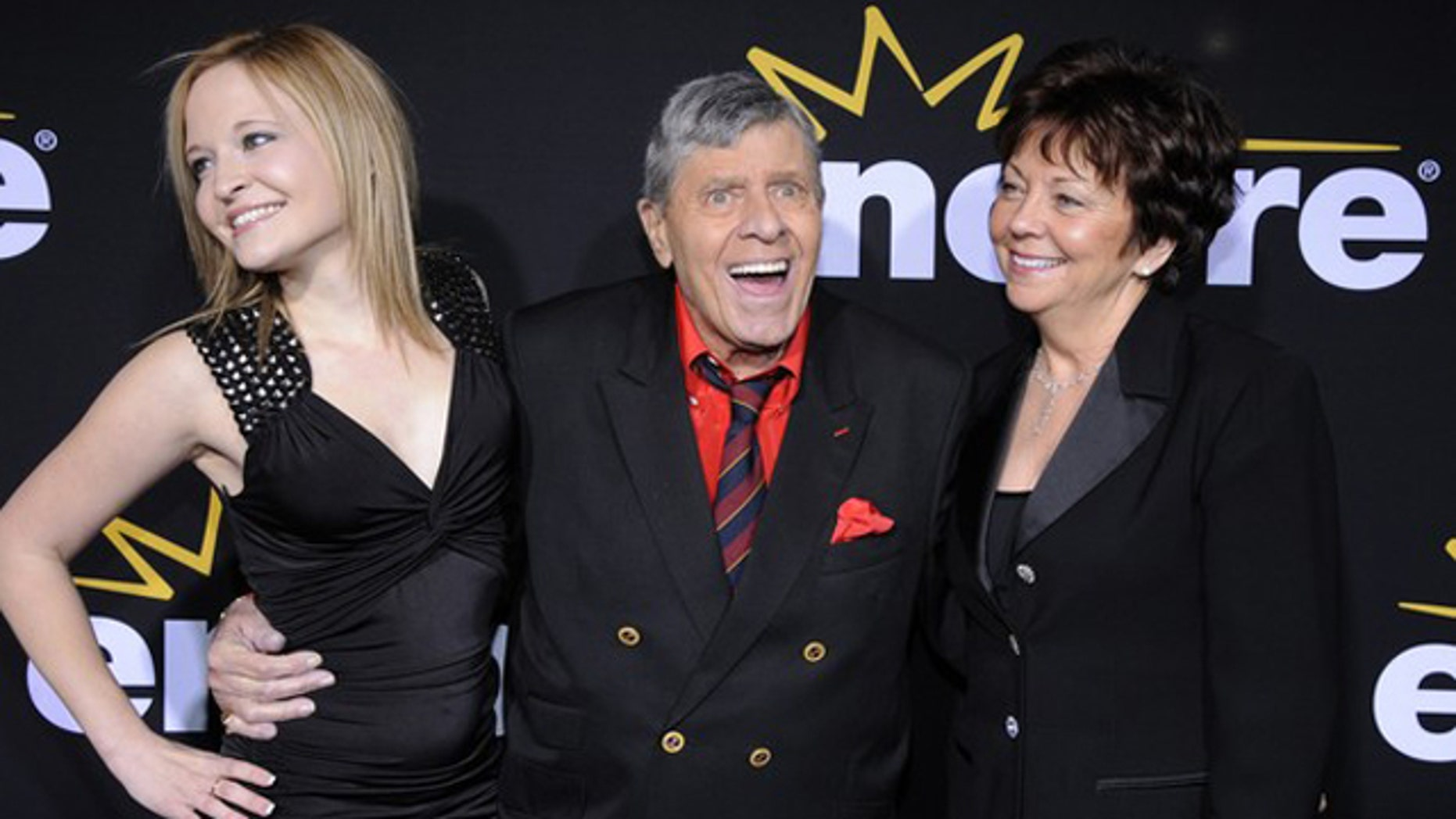 "Dec. 7, 2011: Jerry Lewis (C) attends a special screening of the feature-length documentary ""Method to the Madness of Jerry Lewis"" held at Paramount Studios in Los Angeles, with his wife SanDee Pitnick (R) and daughter Danielle Lewis."