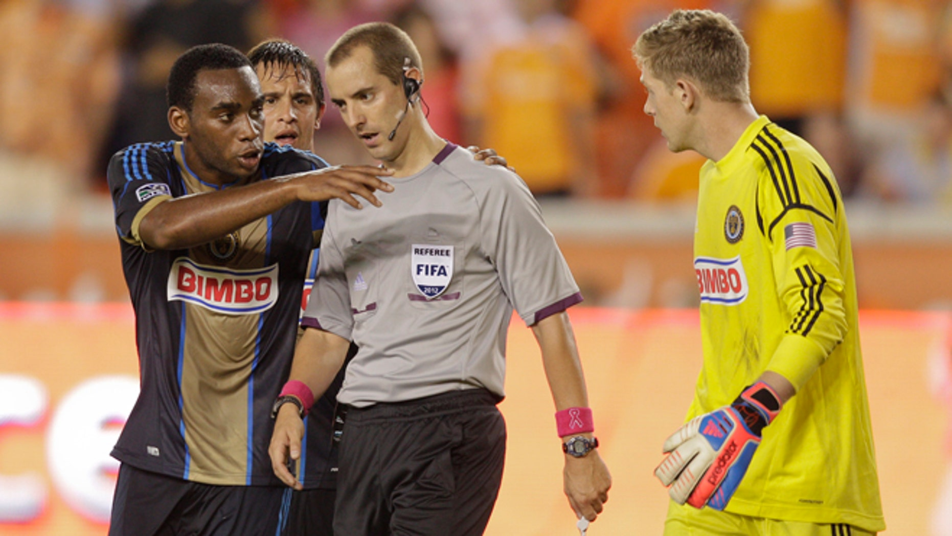 HOUSTON,TX - OCTOBER 20:  Amobi Okugo #14 of the Philadelphia Union pleads with referee Mark Geiger as goalkeeper Zac MacMath #18 of the Philadelphia Union looks on after a penalty kick was given to the Houston Dynamo at BBVA Compass Stadium on October 20, 2012 in Houston, Texas. Houston won 3-1.  (Photo by Bob Levey/Getty Images)