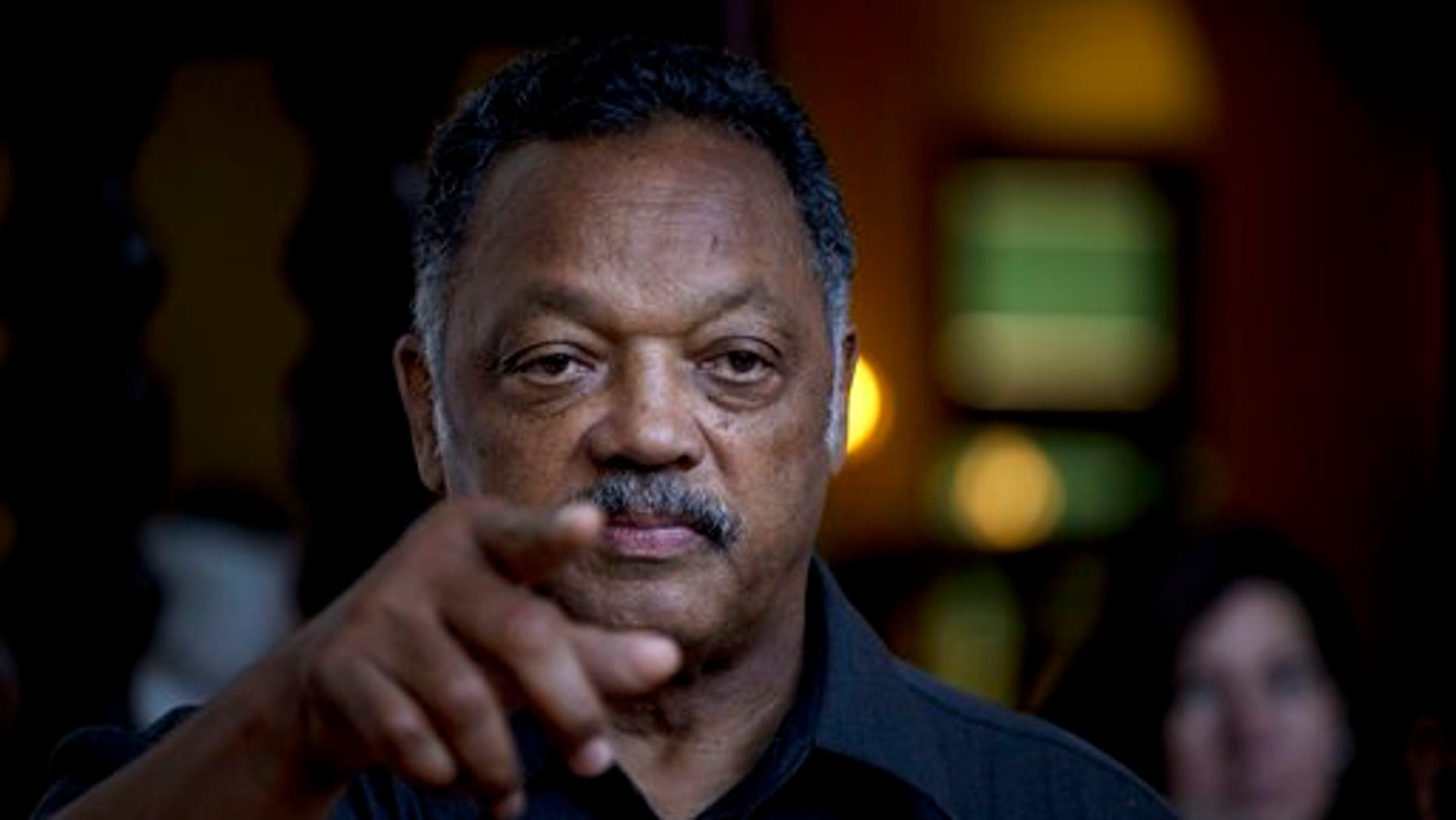 Rev. Jesse Jackson points to a reporter as he takes questions during an impromptu news conference at the Hotel Nacional in Havana, Cuba, Saturday, Sept. 28, 2013. Jackson accepted a request on Saturday by the Revolutionary Armed Forces of Colombia, or FARC, to oversee the release of a U.S. citizen Kevin Scott Sutay kidnapped in June. Jackson says he is in town for talks with religious leaders about their concerns for the poor, and peaceful relations between Cuba, the United States and the rest of the Caribbean. (AP Photo/Ramon Espinosa)