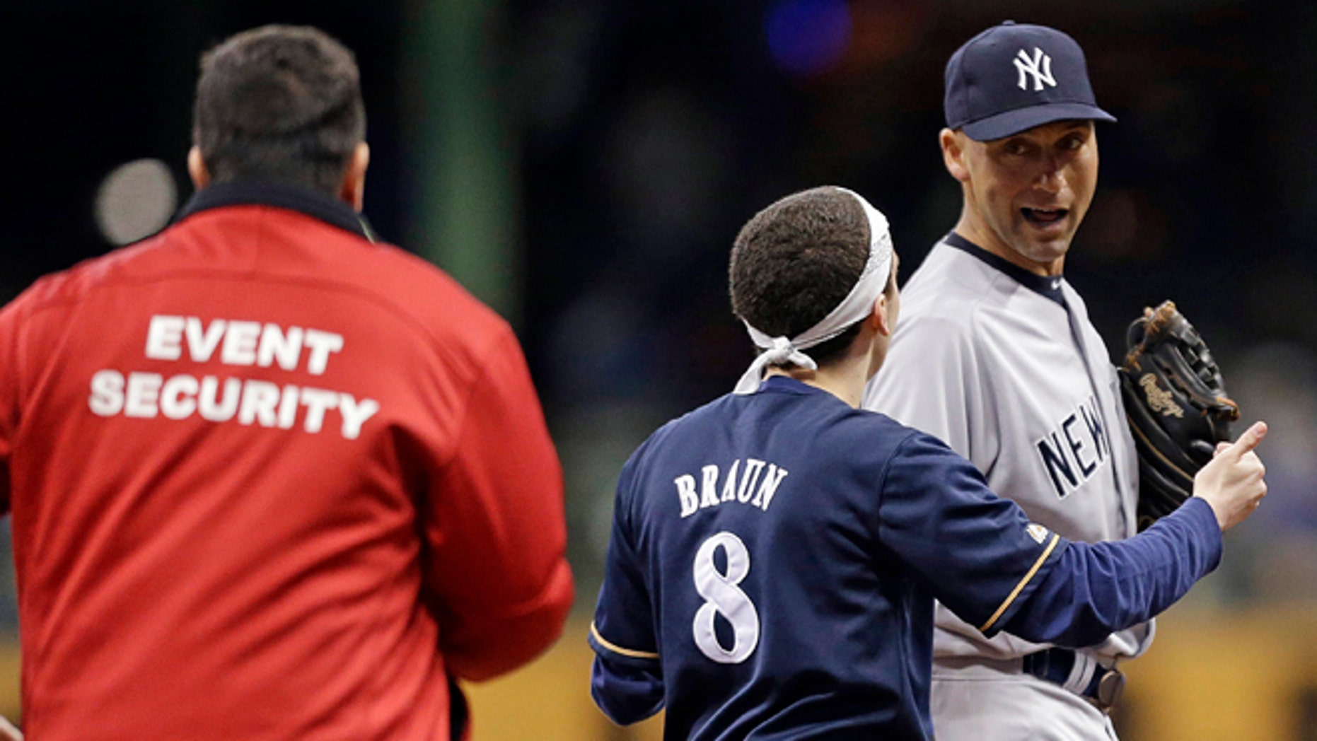 May 9: A fan runs out on the field to New York Yankees' Derek Jeter in the sixth inning of a baseball game against the Brewers in Milwaukee.