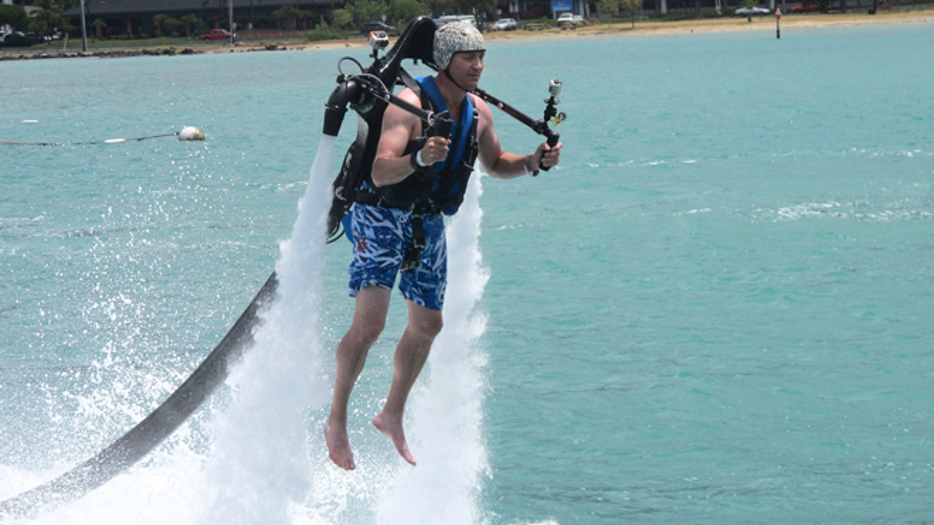 July 19, 2013: In this photo, customer Victor Verlage rides a Jetlev jetpack operated by the company H2O Water Sports Powered by Seabreeze in Honolulu. New devices that pump water fast enough to make people defy gravity are drawing thrill-seekers eager to try the next new watersport, but Hawaii fishermen, scientists and state officials are questioning their safety and how they may affect fish, coral and other fragile natural resources in the islands.