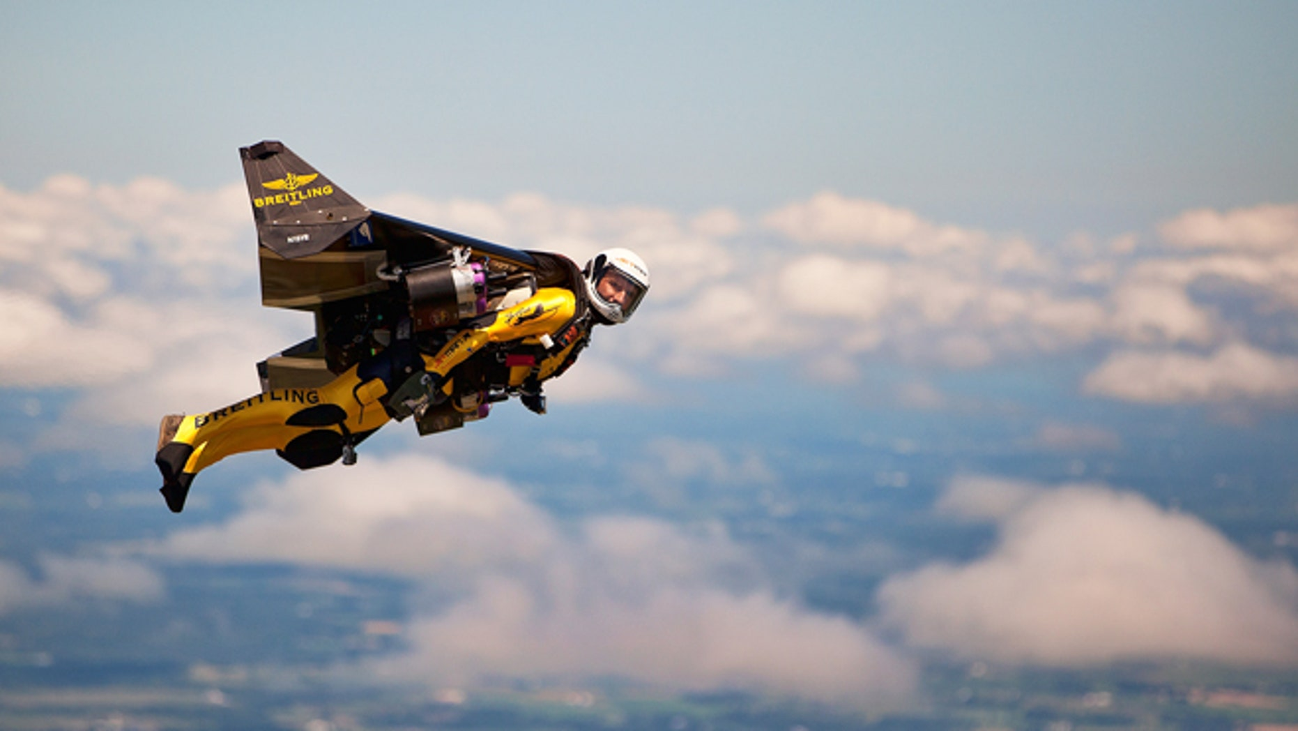 "July 29, 2013: Swiss adventurer Yves Rossy, also known as ""Jetman,"" flies in his carbon-Kevlar jetwing with four engines for during an event for reporters over Appleton, Wis."