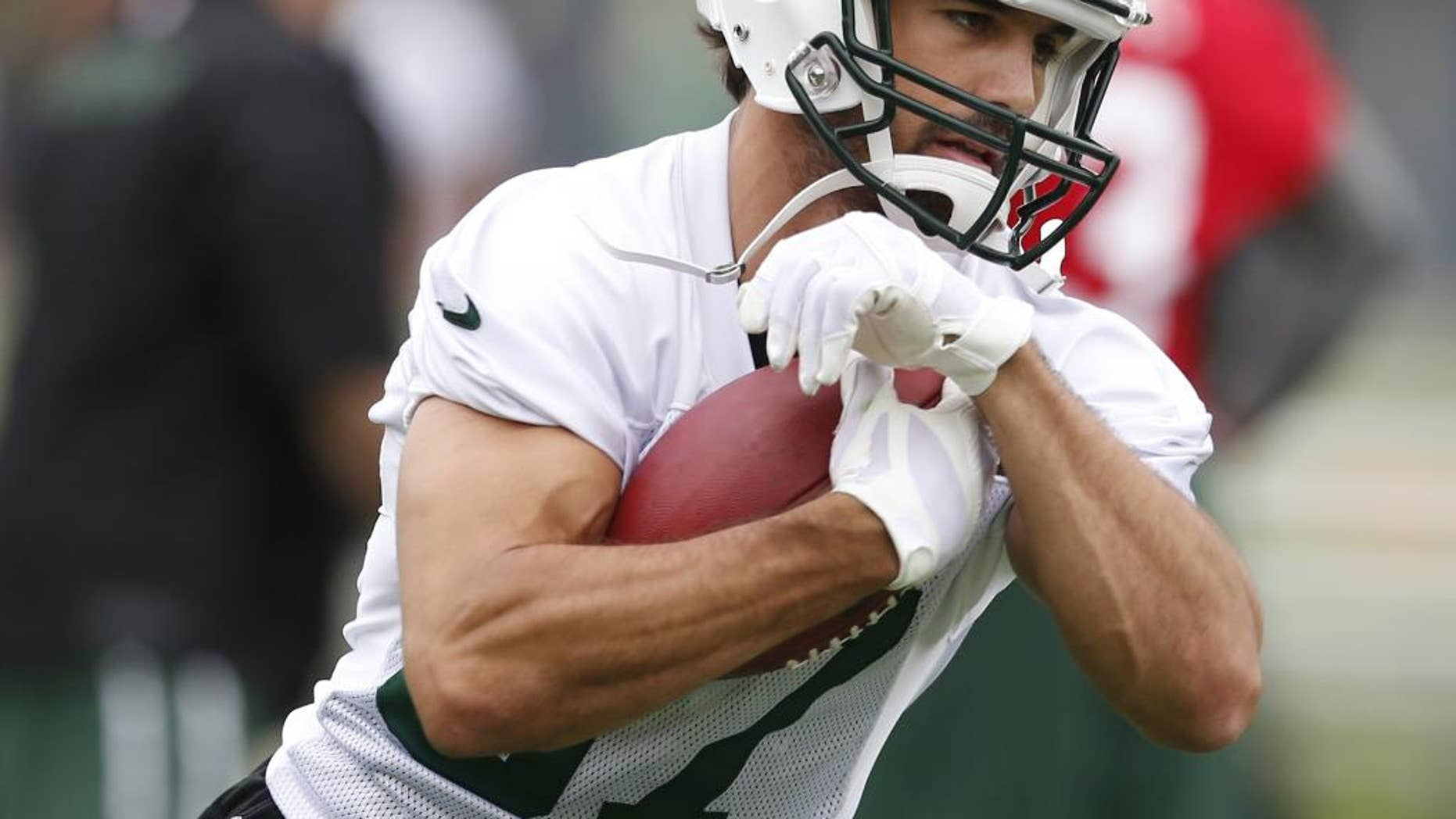 FILE - In this May 28, 2014, file photo, New York Jets wide receiver Eric Decker runs with the ball during an NFL football organized team activity in Florham Park, N.J. The Jets went into the offseason needing to upgrade their receiving corps in a big way. Now, they all need to mesh in Marty Mornhinweg's offense.  (AP Photo/Julio Cortez, File)